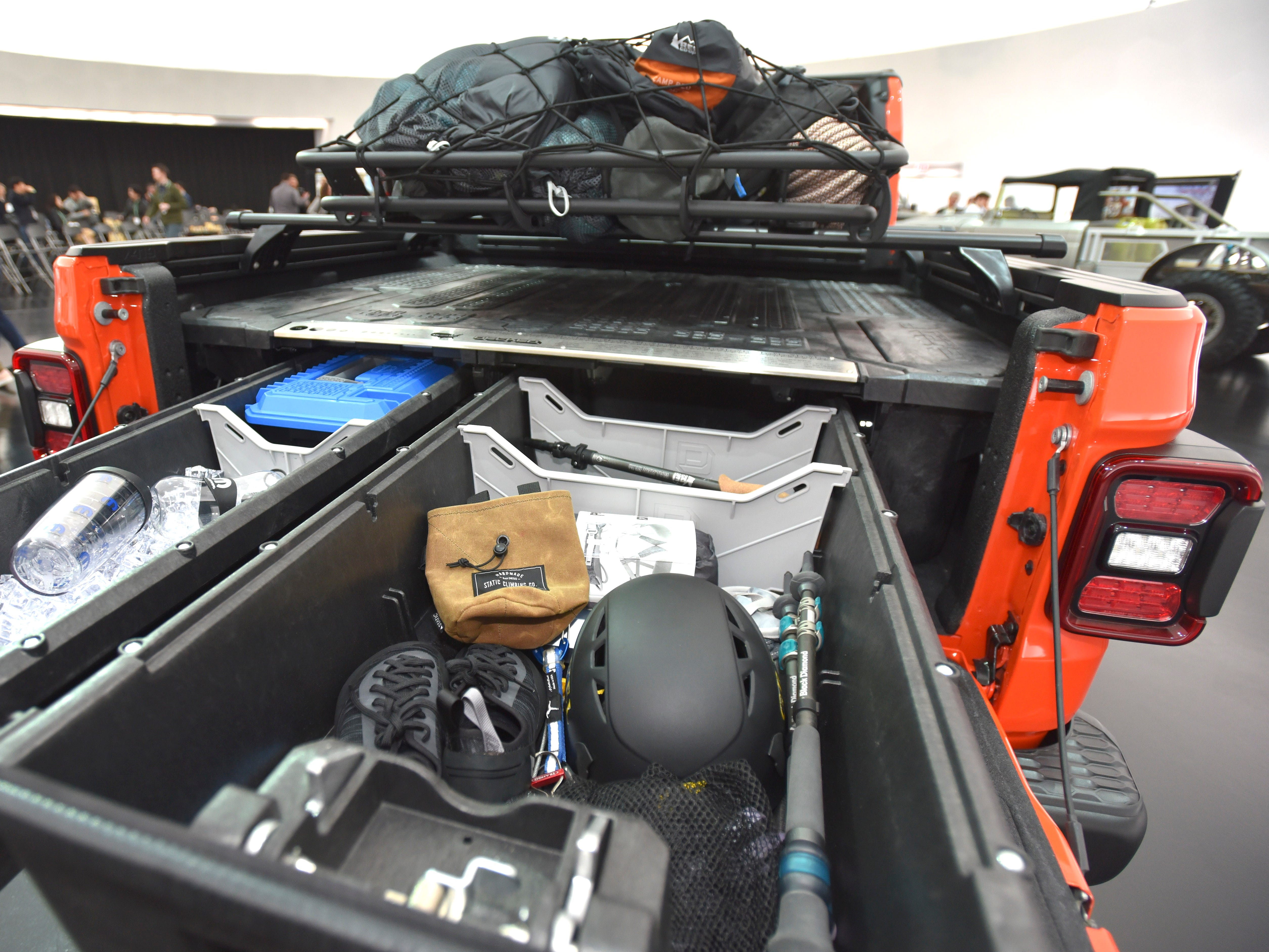 In the bed of the Jeep Gladiator Gravity is a Mopar/Decked bed-drawer system for dry, lockable storage.