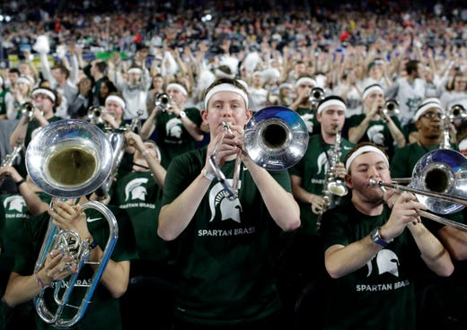 Michigan State pep band members play during the second half.
