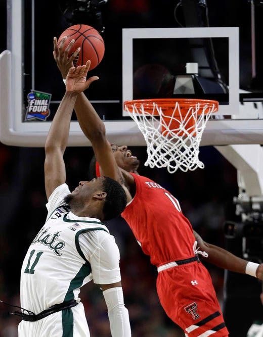 Michigan State forward Aaron Henry, left, fights for a rebound with Texas Tech forward Tariq Owens during the first half.