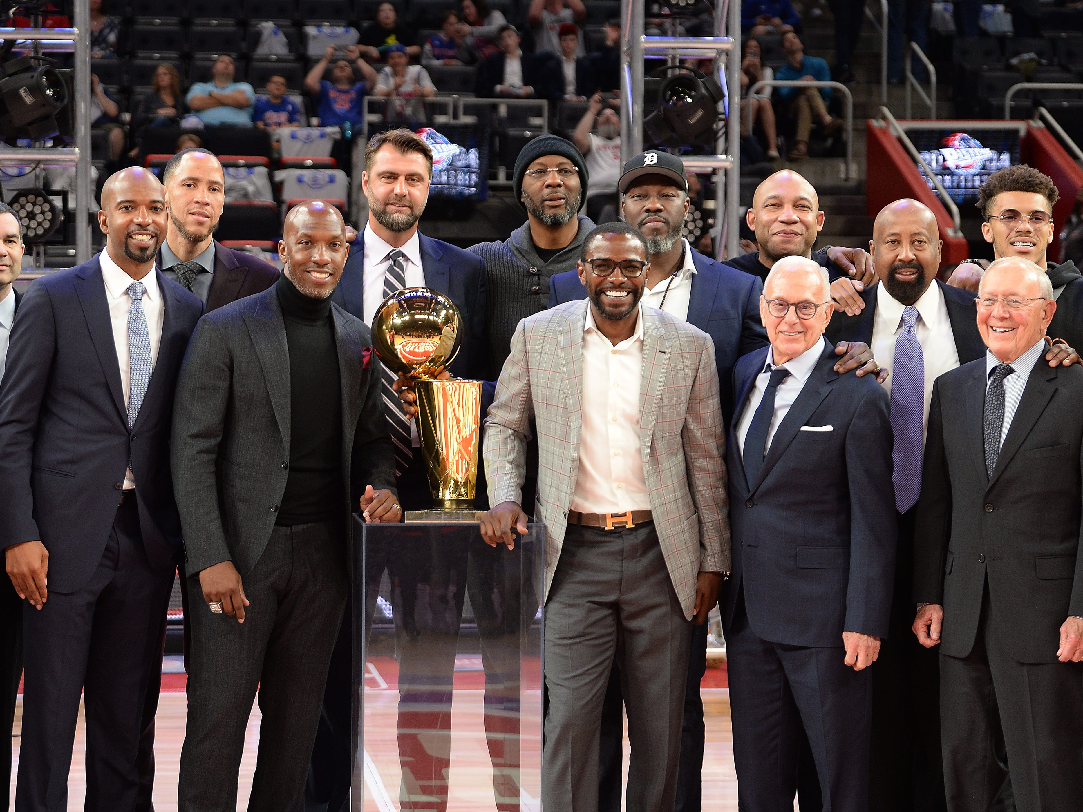 Members of the 2004 Championship team pose for a photo at the end of the ceremony that honored  the team.