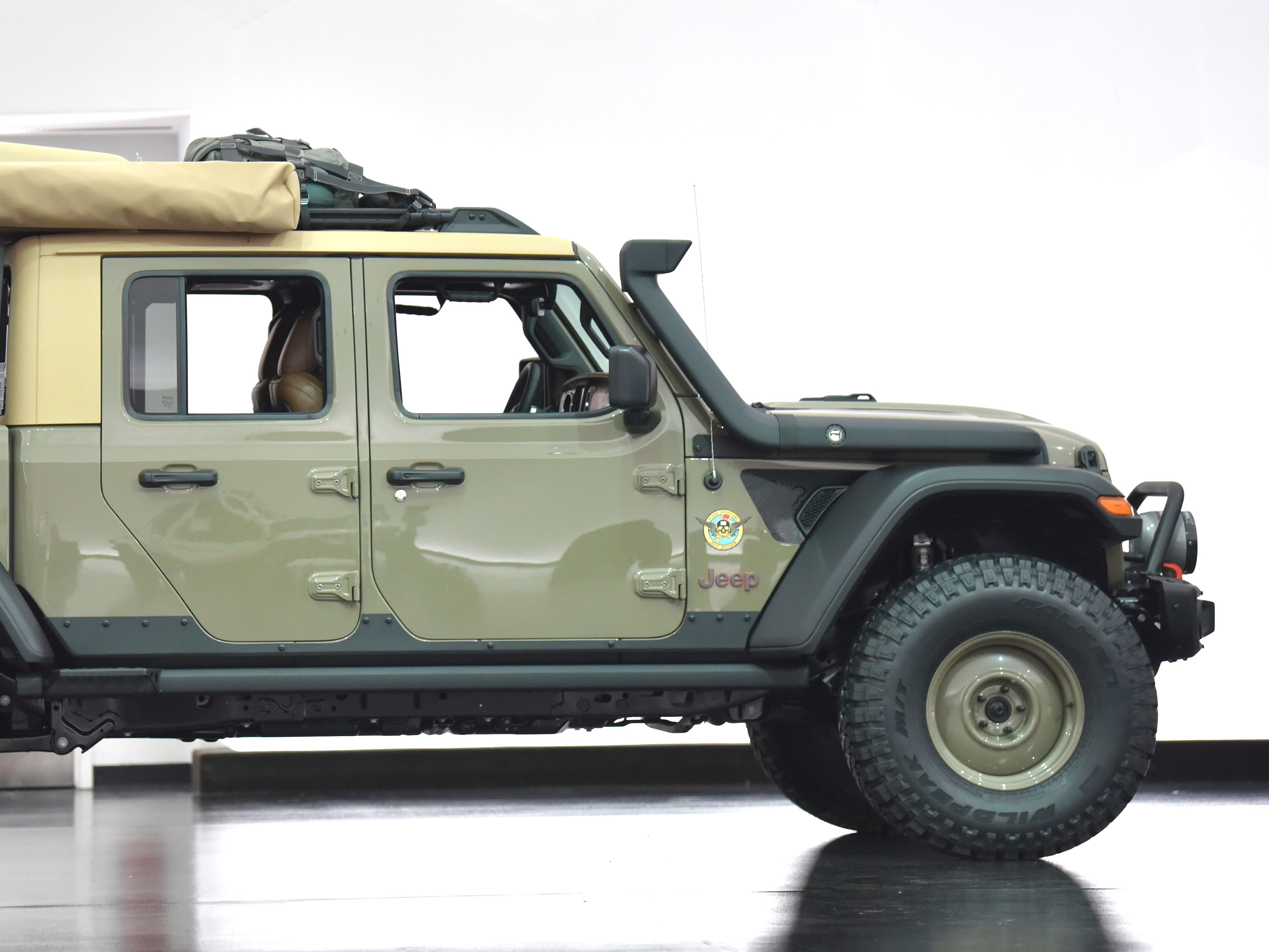 This is the Jeep Wayout, an overland concept vehicle, colored in Gator Green.