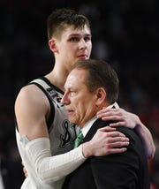 Michigan State senior Matt McQuaid hugs head coach Tom Izzo coming off the court late in the game.