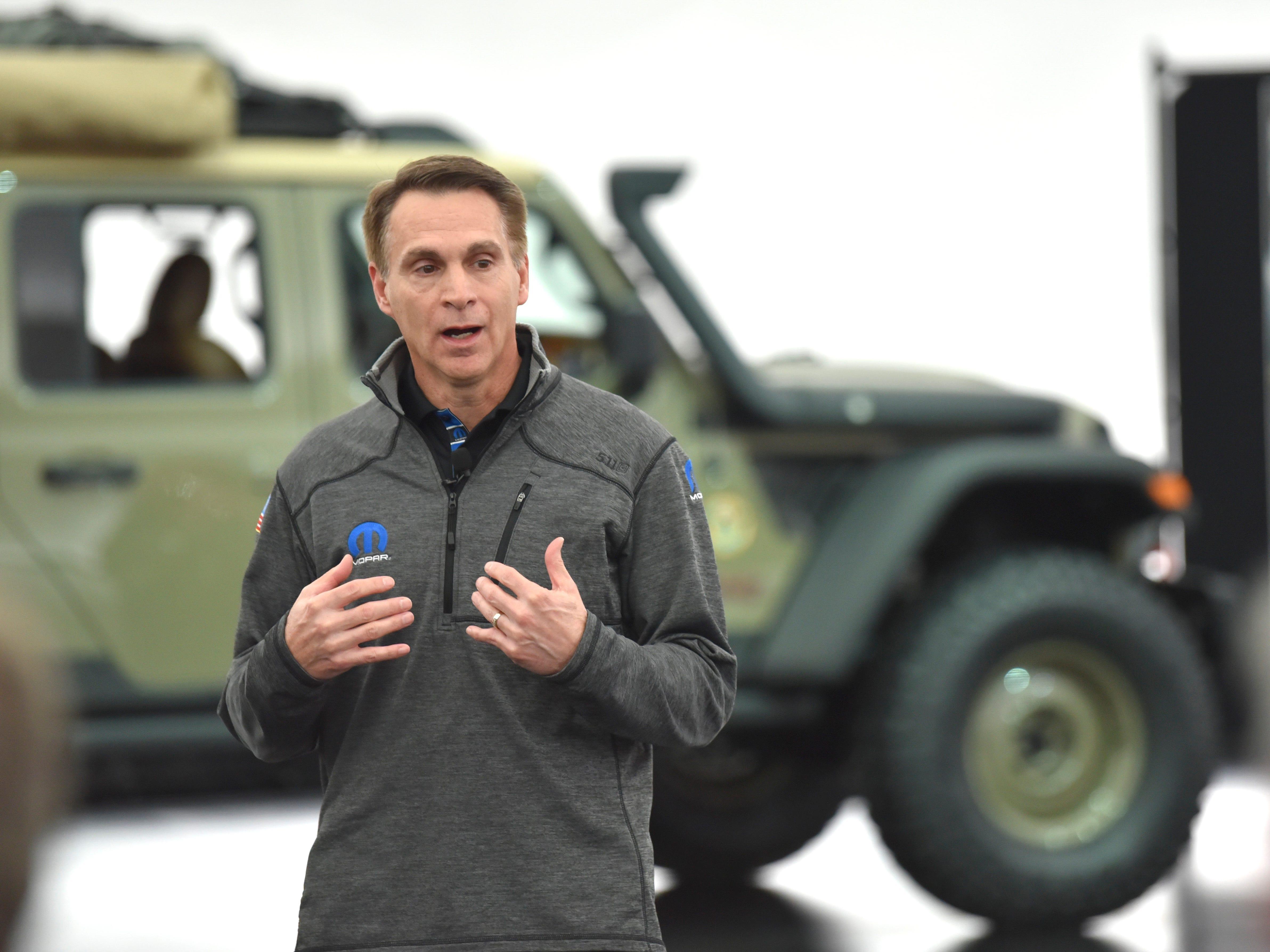Steve Beahm, head of parts and service (Mopar) and passenger car brands, talks near the Jeep Wayout.
