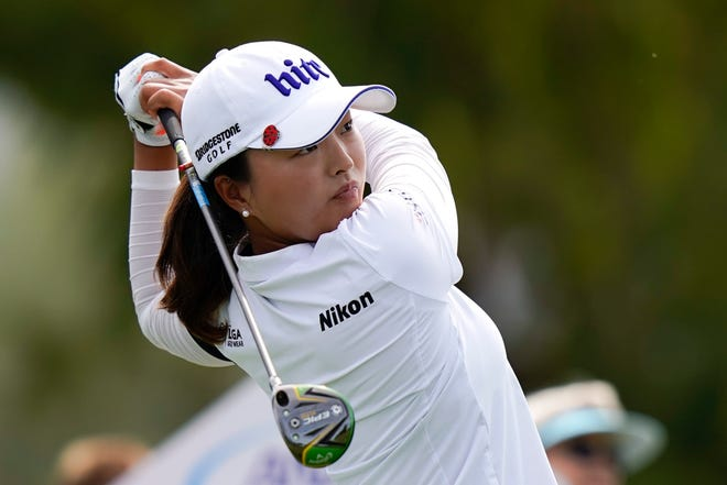 Jin Young Ko watches her tee shot on the seventh hole.