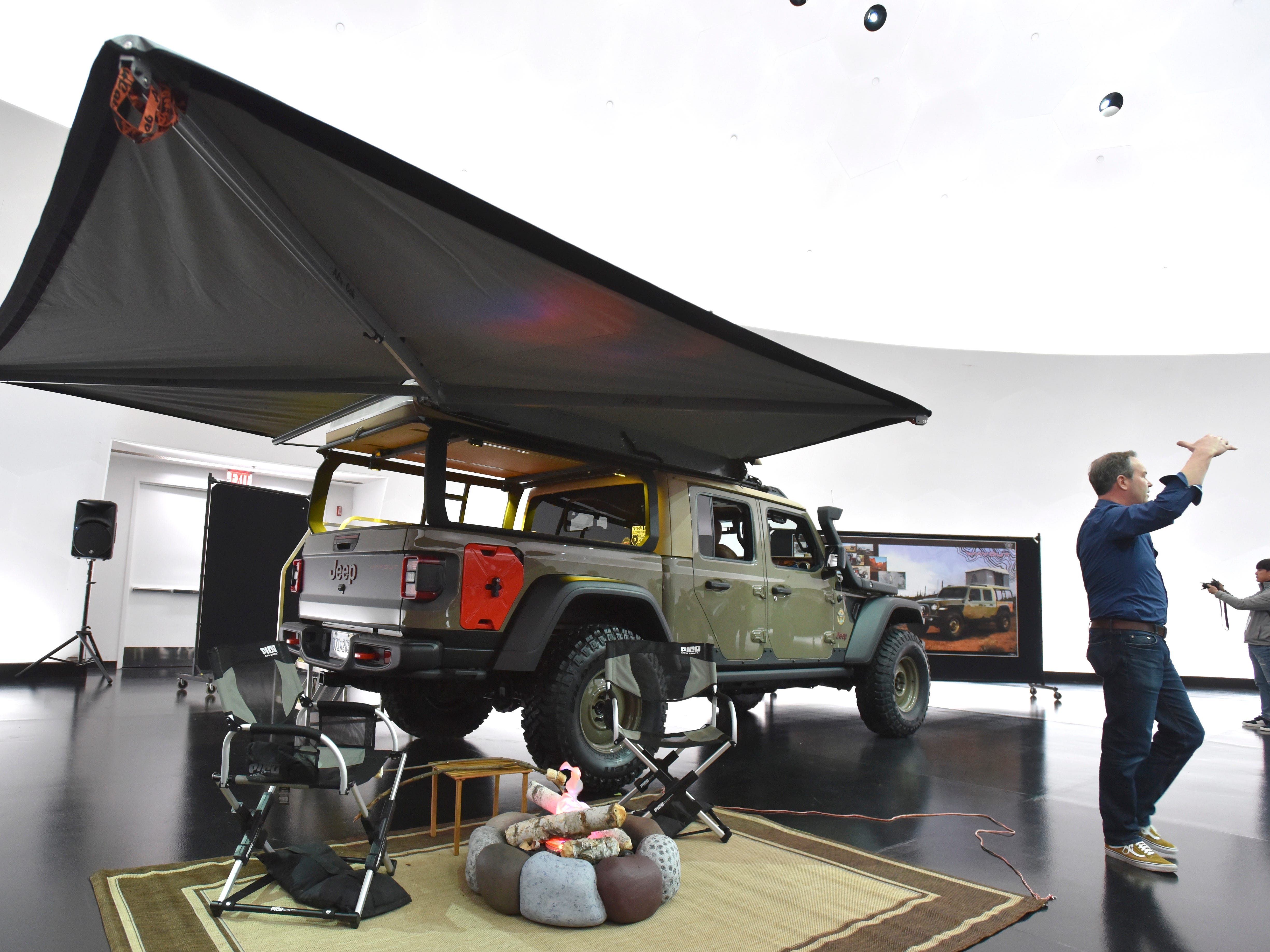 Mark Allen, Head of Jeep Design, talks about the Jeep Wayout, an overlanding concept vehicle, with a full roof-top tent and custom canopy.