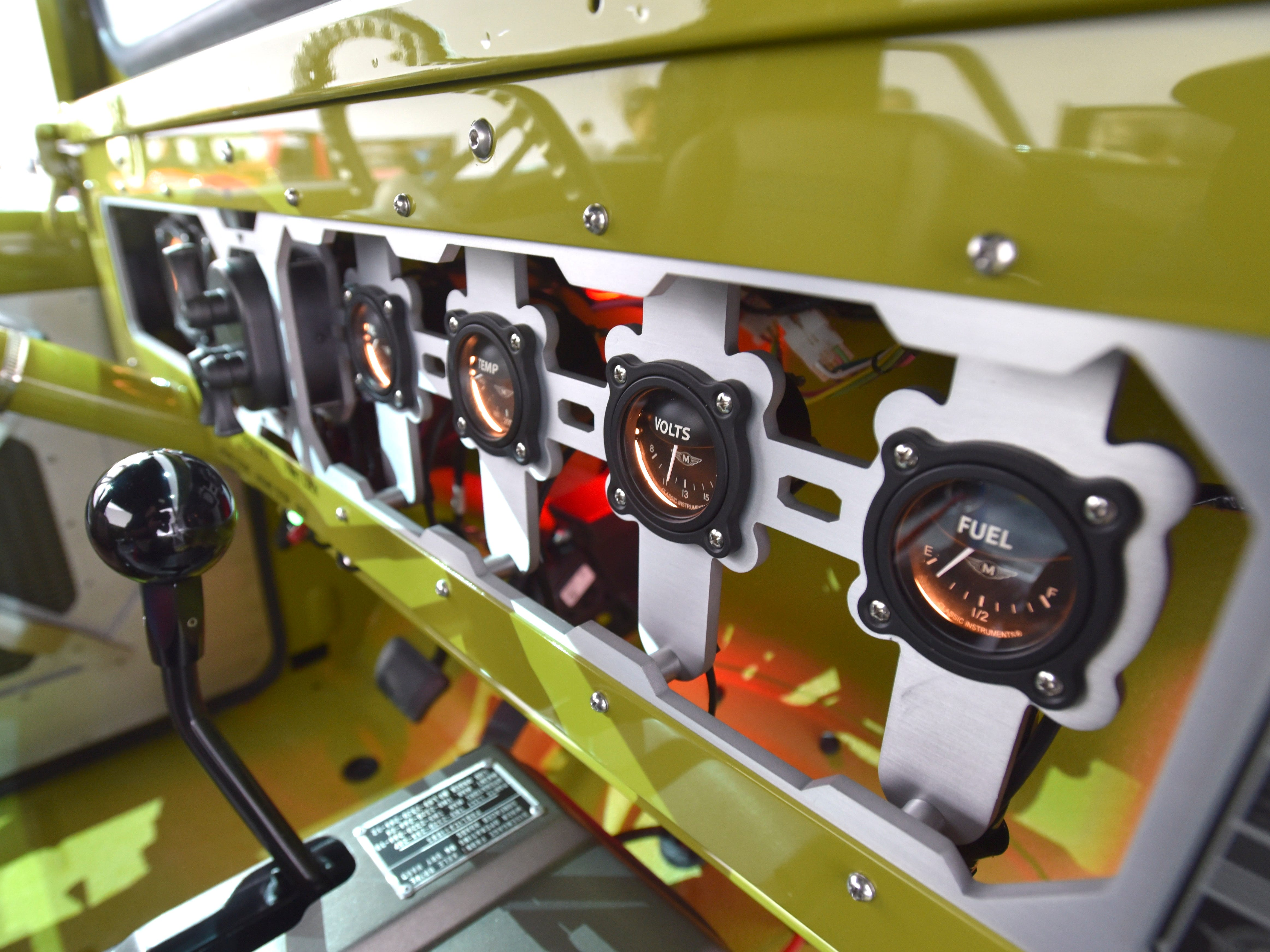 This is the stacked water jet cut aluminum-gauge cluster with aircraft-style gauges in the Jeep M-715 Five-Quarter.