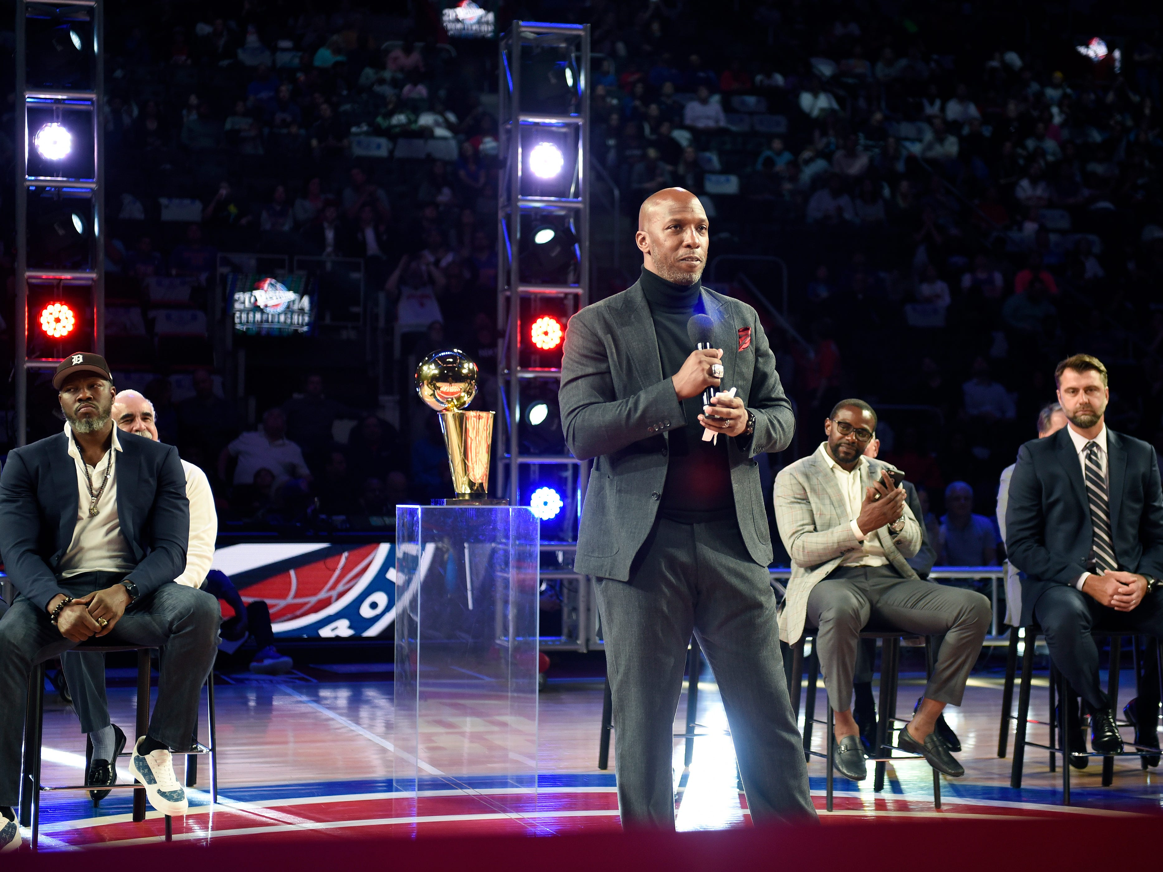 Former Piston Chauncey Billups gives his remarks during the halftime ceremony honoring the  2004 Championship team.