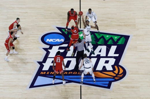 Players get set for the opening tip during the first half between Michigan State and Texas Tech in the semifinals of the Final Four NCAA college basketball tournament, Saturday, April 6, 2019, in Minneapolis.