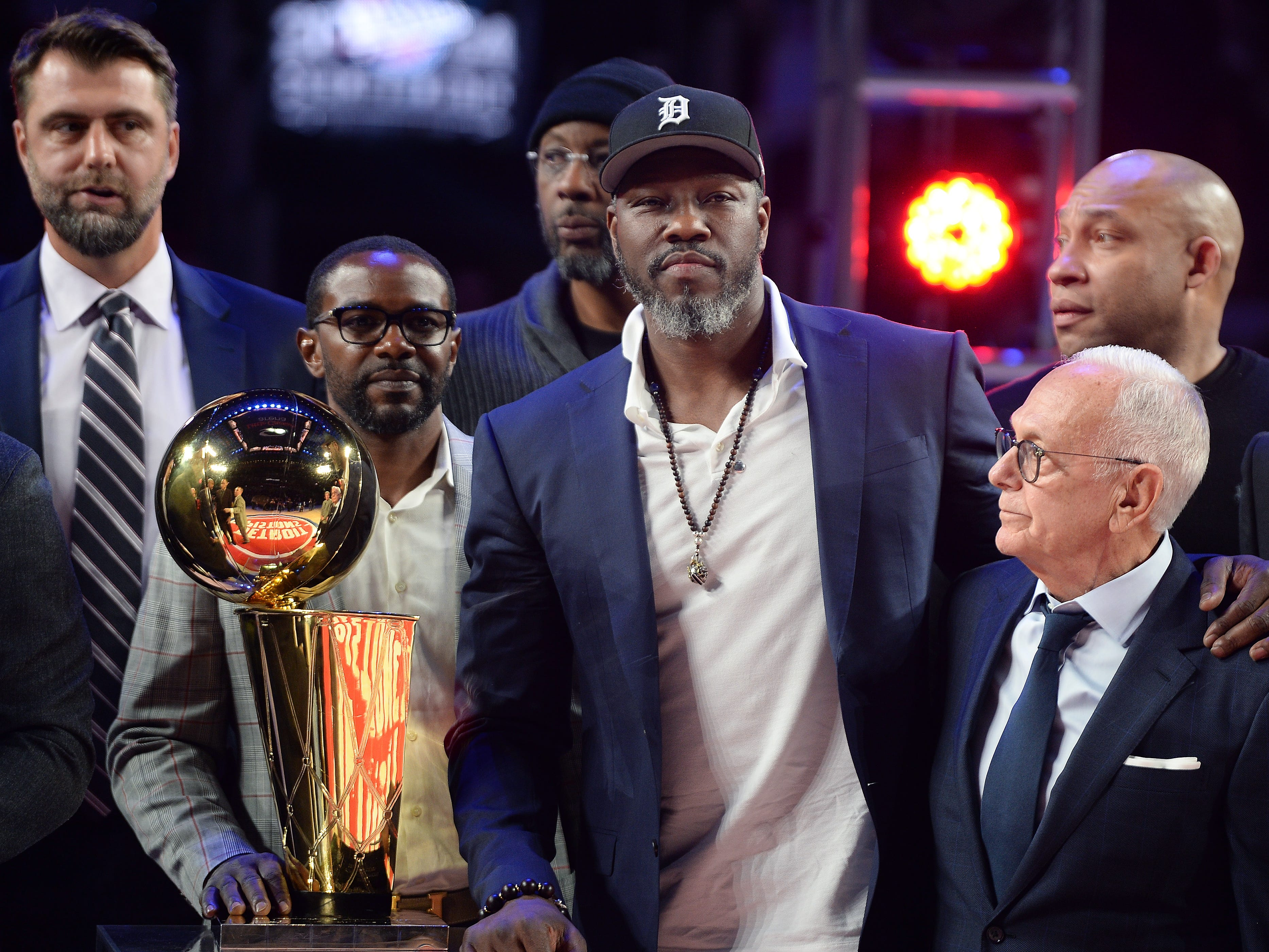 From left, Former Pistons Mike James, Ben Wallace and head coach Larry Brown during the ceremony to honor the 2004 Championship team.