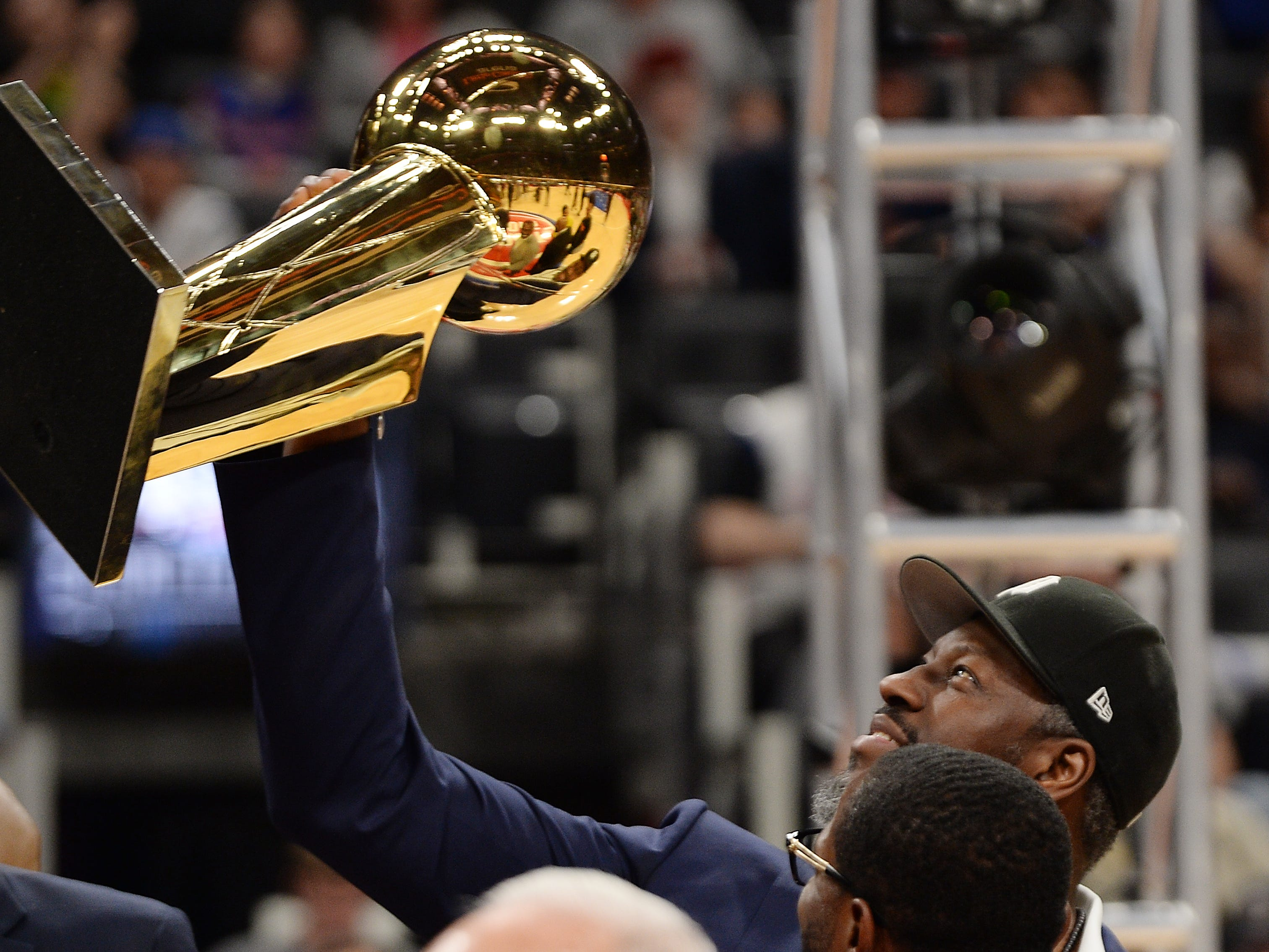 Former Piston Ben Wallace holds the 2004 Championship trophy at the end of the ceremony honoring the 2004 Champs.