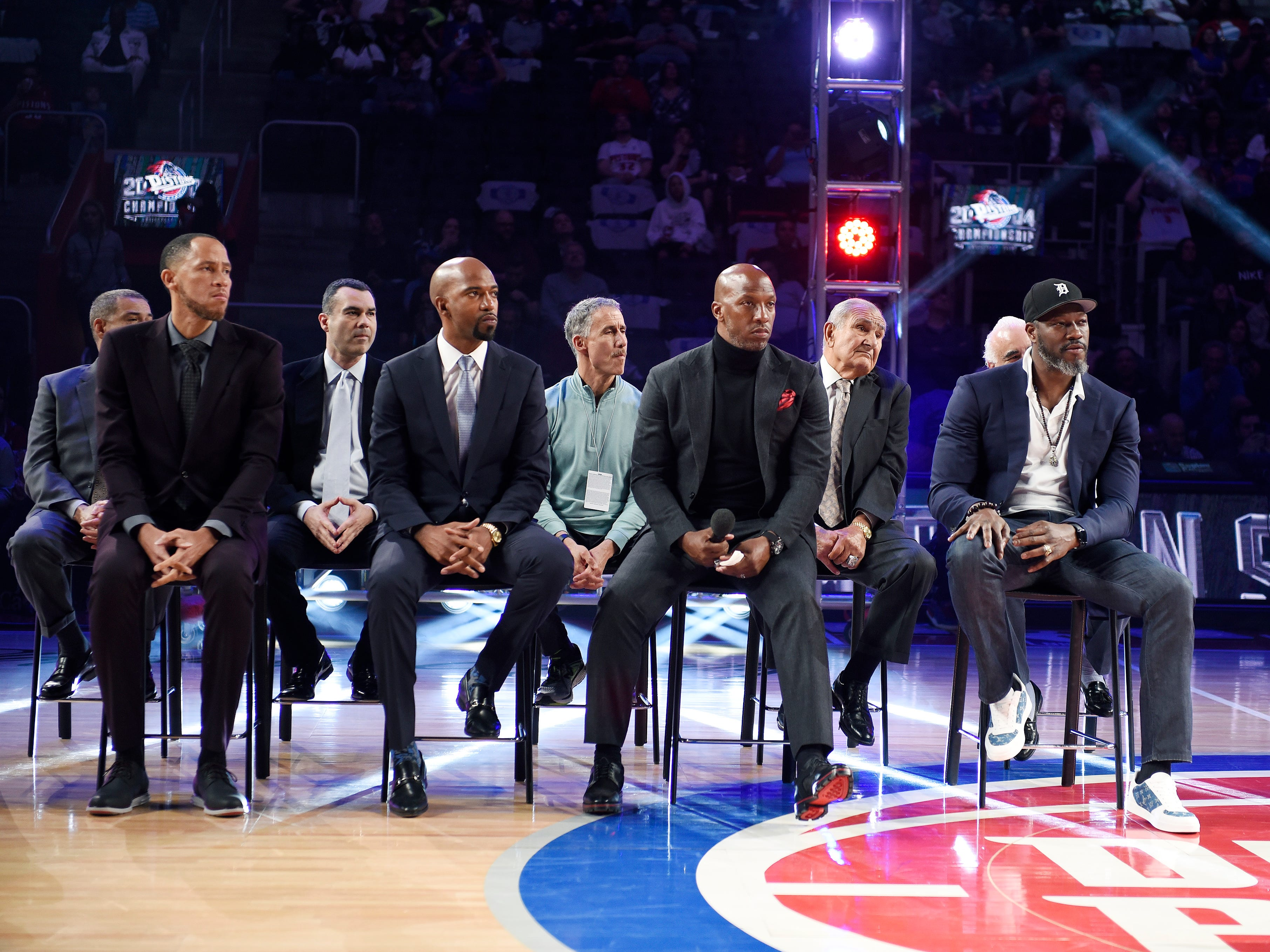 From left, Former Pistons Tayshaun Prince, Richard Hamilton, Chauncey Billups and Ben Wallace listen during the ceremony honoring the 2004 Championship team.