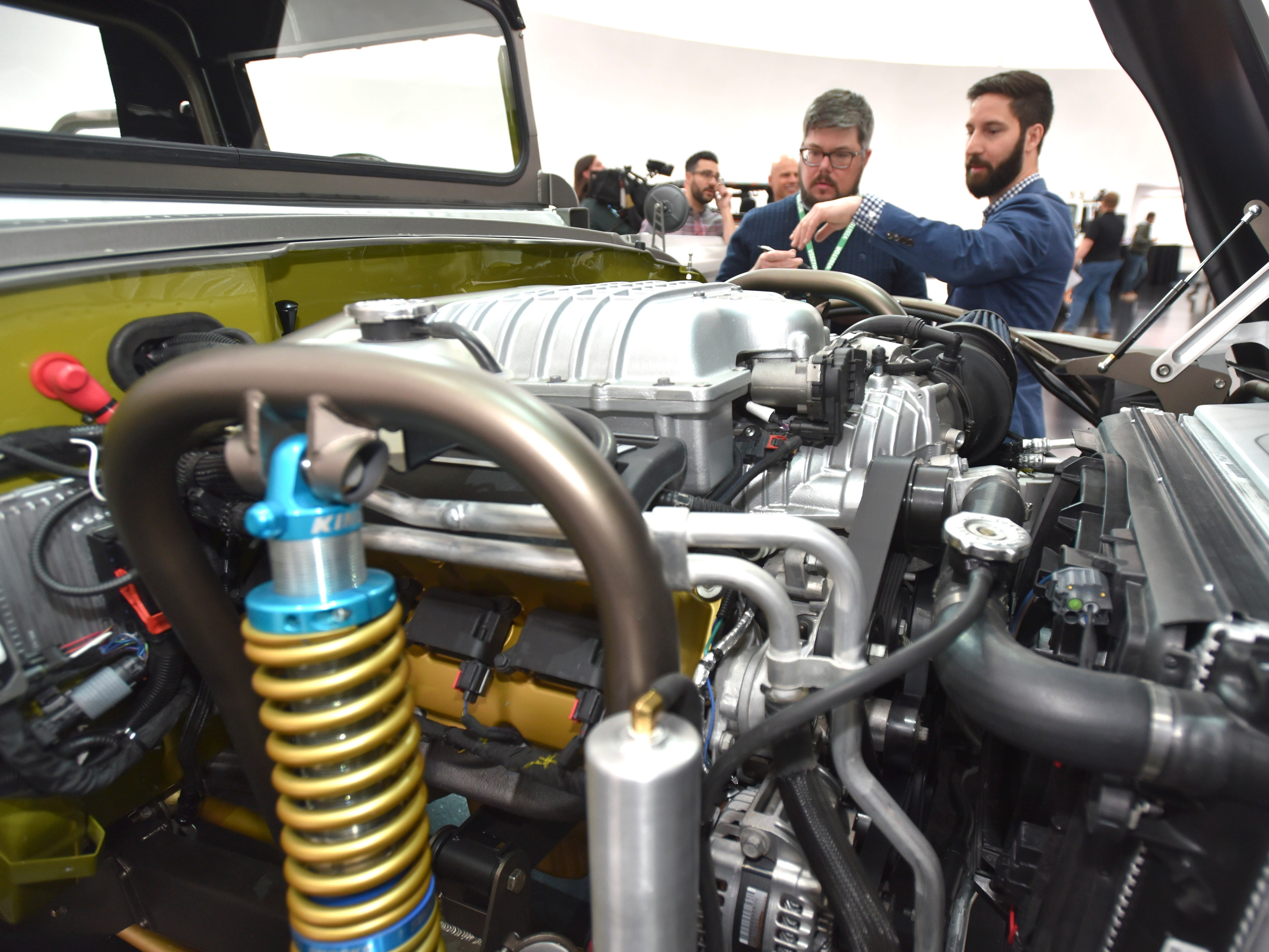 This is the 6.2-liter, supercharged 'Hellcrate' HEMI V-8 engine, which produces more than 700 horsepower on the Jeep M-715 Five-Quarter