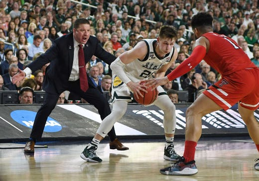 Texas Tech's head coach Chris Beard does some sideline defending on Michigan State's Matt McQuaid in the first half in the NCAA Final Four semifinals at U.S. Bank Stadium in Minneapolis, Minnesota on April 6, 2019.