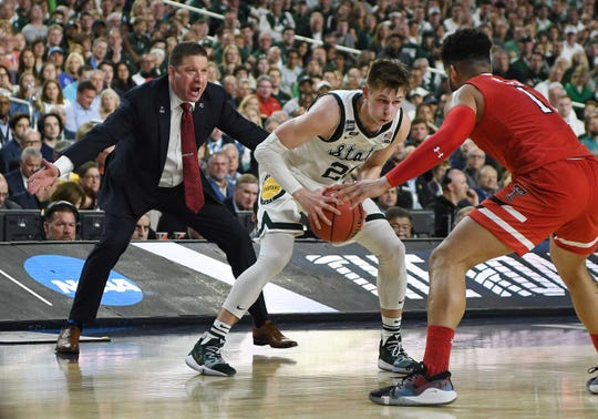 Texas Tech's head coach Chris Beard does some sideline defending on Michigan State's Matt McQuaid in the first half.