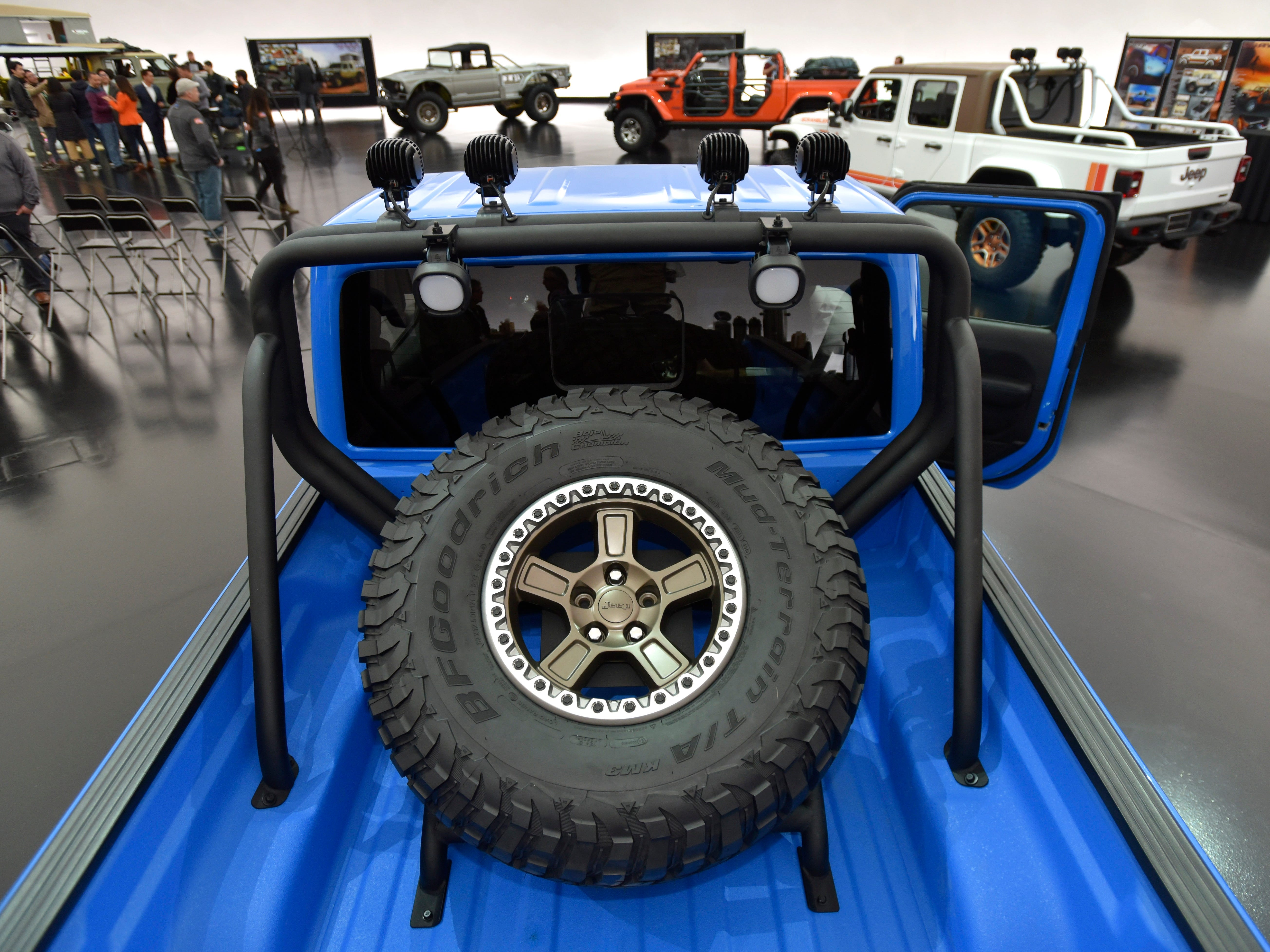 This is a roll bar and spare tire in the bed of the Jeep J6 concept in Metallic Brilliant Blue.