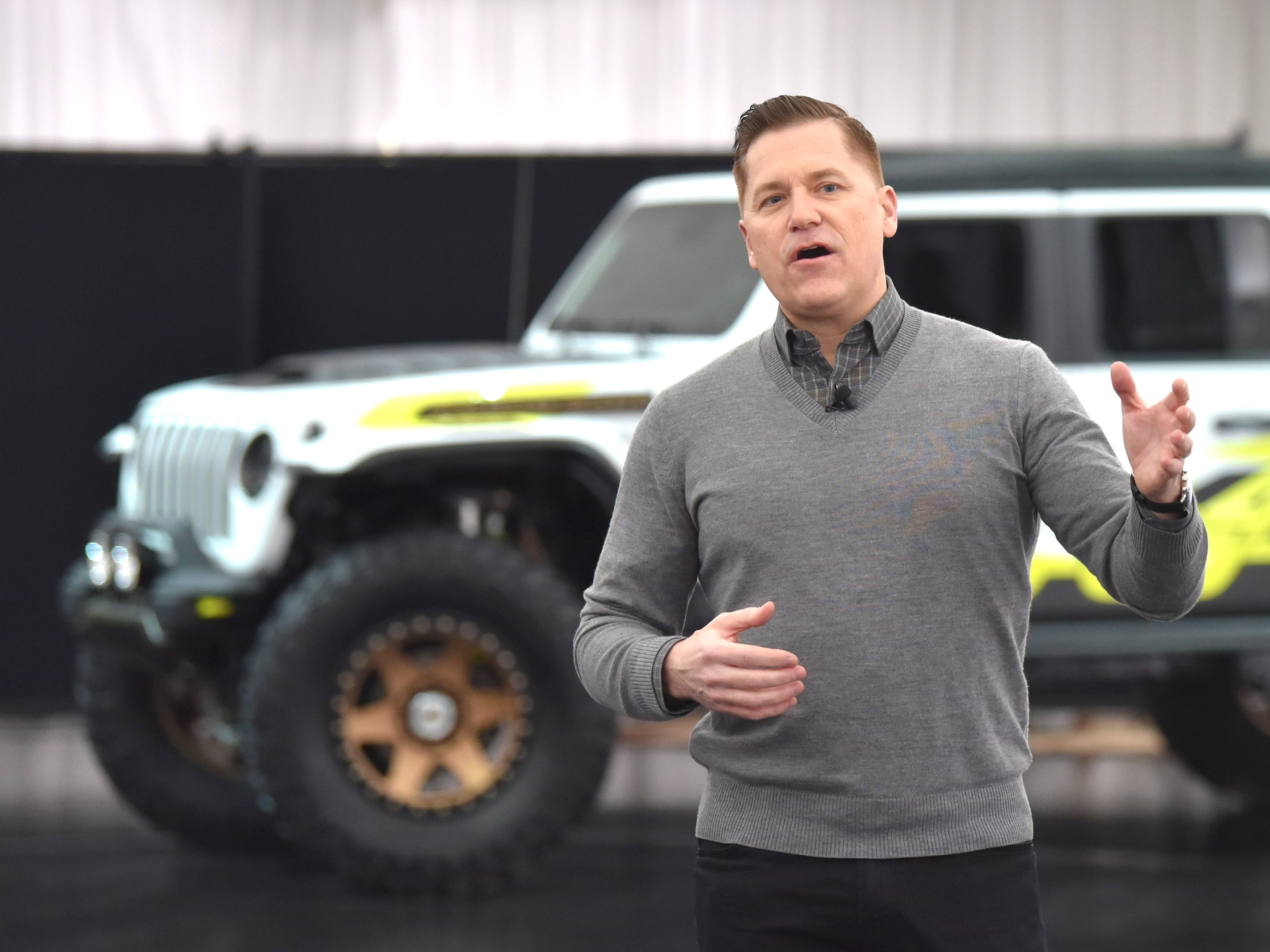 Tim Kuniski, Head of Jeep Brand - North America, talks in front of the Jeep Flatbill, colored in white and acid green as several Jeep and Mopar executives unveil six concept vehicles, Friday morning, April 5, 2019, inside the FCA Design Dome in Auburn Hills prior to the 53rd Annual Moab Easter Jeep Safari. The annual event takes place in Moab, Utah, April 13-21, where thousands of off-road enthusiasts will participate in technical off-roading.