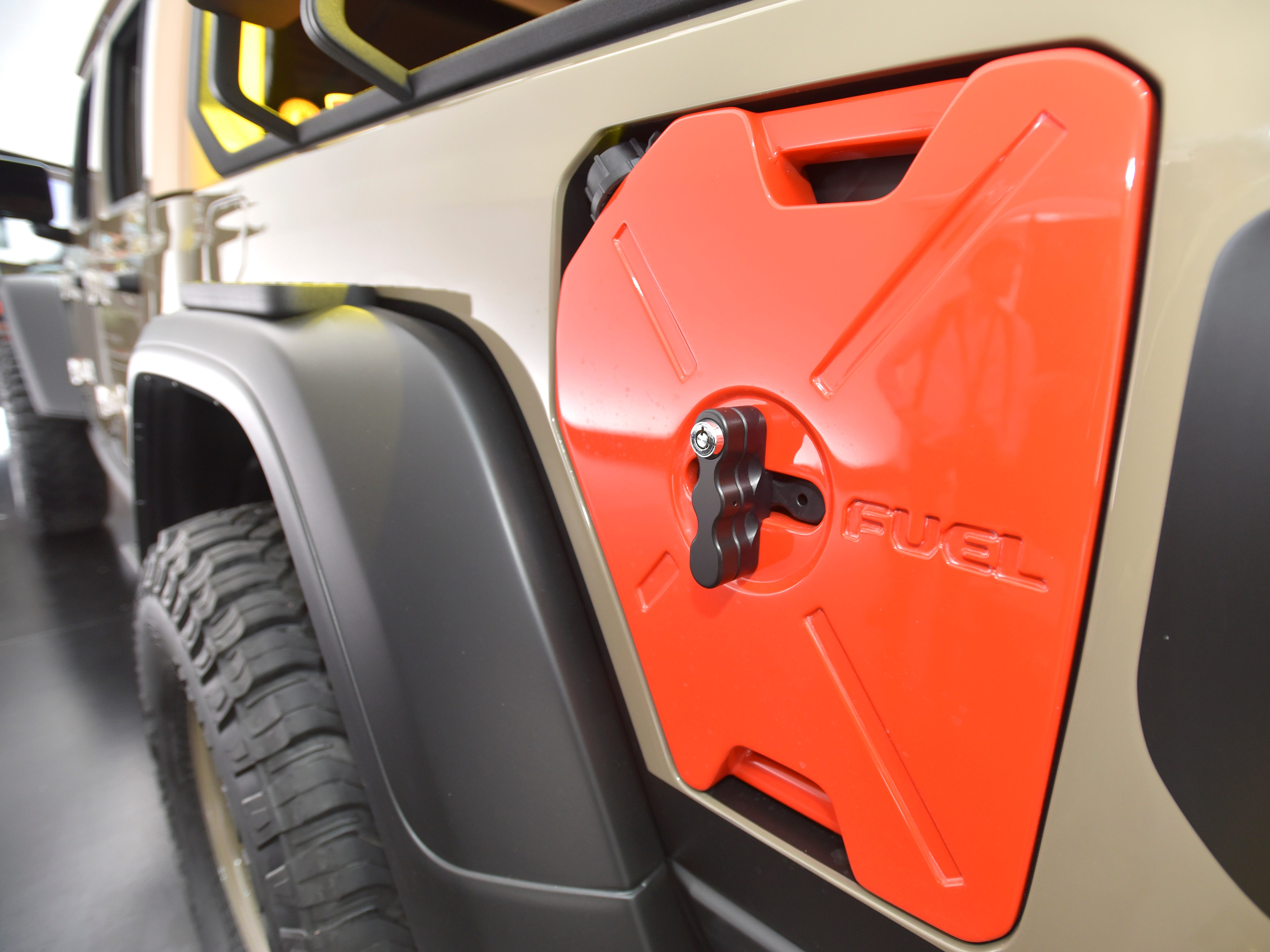 The Jeep Wayout has two custom-fit auxiliary fuel tanks integrated into each bedside.