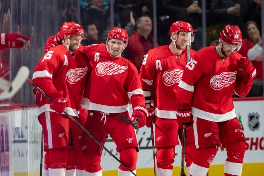From left, Red Wings defenseman Niklas Kronwall, center Dylan Larkin, left wing Justin Abdelkader, and defenseman Mike Green celebrate a goal by Larkin in a December game at Little Caesars Arena.