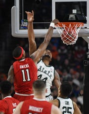 Texas Tech's Tariq Owens slams on Michigan State's Nick Ward in the first half.