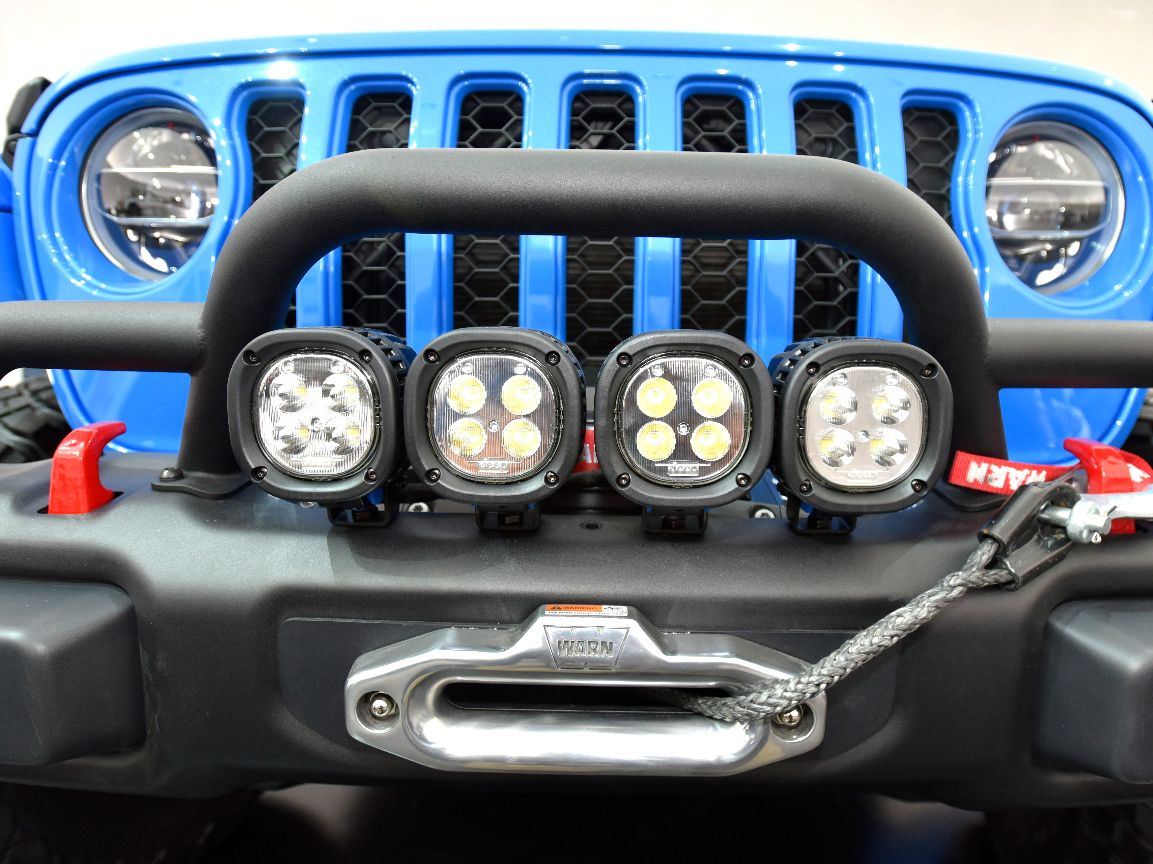 These are four, five-inch LED off-road lights on top of the front bumper, which also houses a winch on the Jeep J6 concept in Metallic Brilliant Blue.