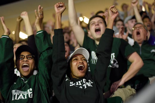 Michigan State sophomore Erynne Dixon, front, cheers as the Spartans score a first half basket against Texas Tech.