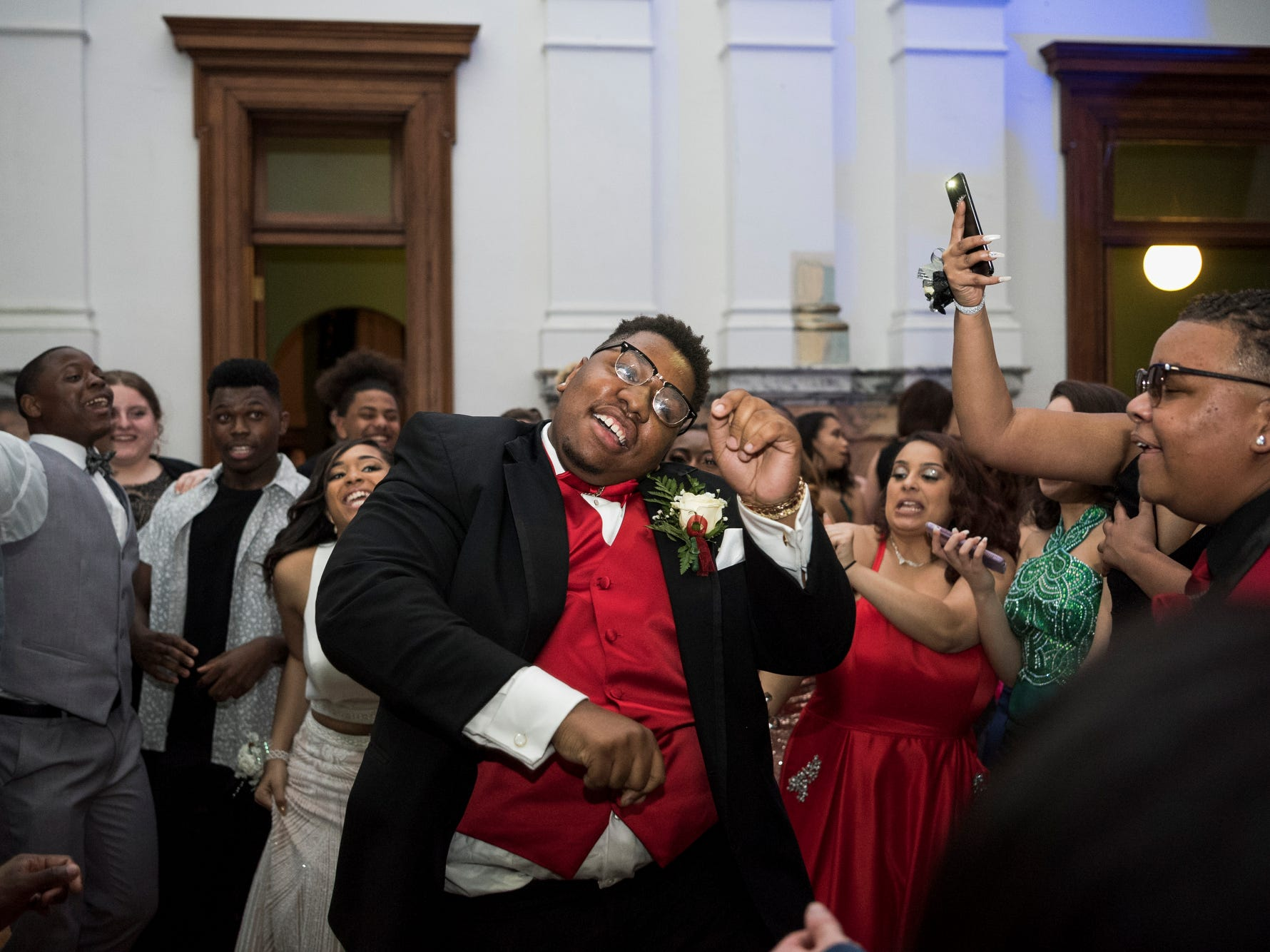 Bosse High School student Dalton Crowell dances as music thumps and the floor shakes during prom at the Old Vanderburgh County Courthouse in downtown Evansville, Ind., Saturday, April 6, 2019.