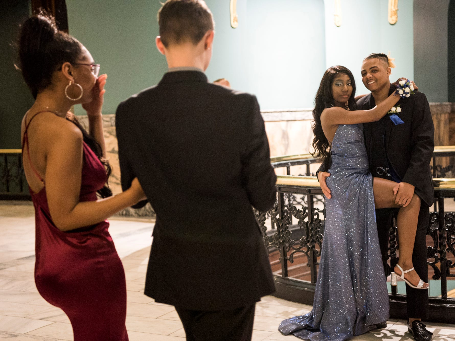 Maleaya Labrador laughs as her date Peyton Lamar takes a picture of their friends Darnell McRath Jr. and Breasia Williams during Bosse High School's prom at the Old Vanderburgh County Courthouse in downtown Evansville, Ind., Saturday, April 6, 2019.
