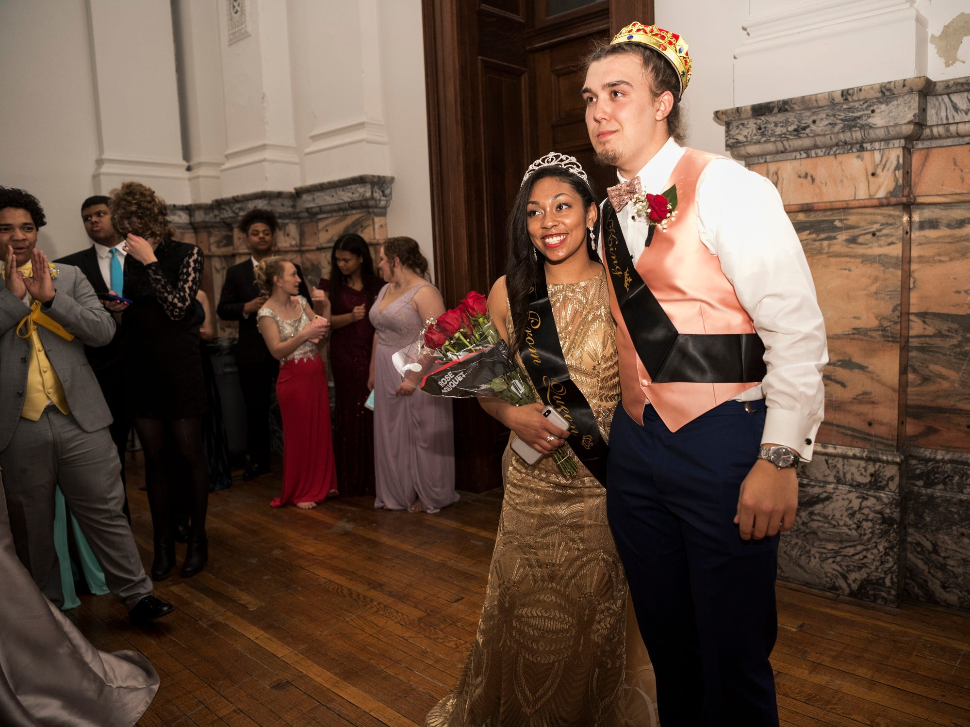 Bosse High School students Jasmine Catlett and Kyran Husk pose for pictures after being named 2019 prom queen and king during the dance at the Old Vanderburgh County Courthouse in downtown Evansville, Ind., Saturday, April 6, 2019.