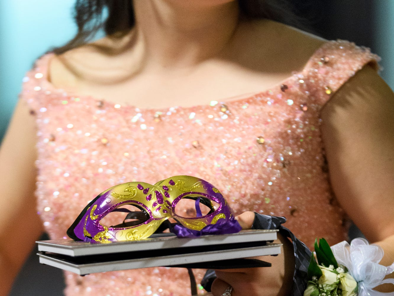 Alexa Wheeler leaves Bosse High School's prom with a handful of goodies at the Old Vanderburgh County Courthouse in downtown Evansville, Ind., Saturday, April 6, 2019.