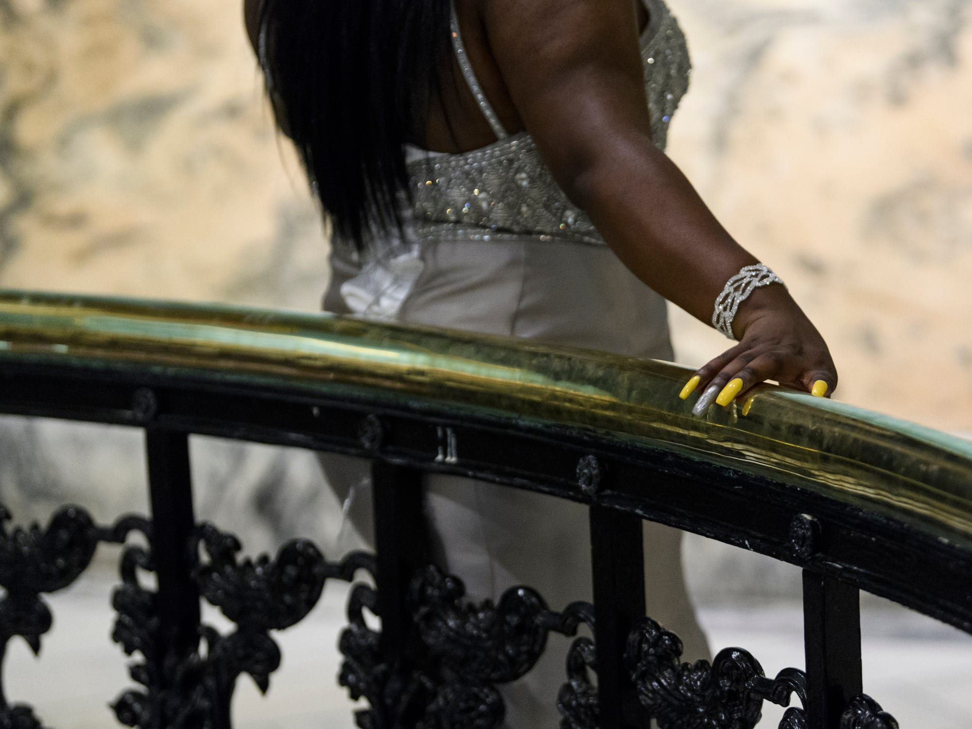 Taesheanna Brown poses for a picture on the second floor of the Old Vanderburgh County Courthouse during Bosse High School's prom in downtown Evansville, Ind., Saturday, April 6, 2019.