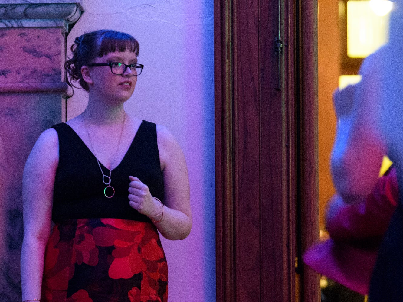 Bosse High School student Caroline Martin watches other students on the dance floor during prom at the Old Vanderburgh County Courthouse in downtown Evansville, Ind., Saturday, April 6, 2019.