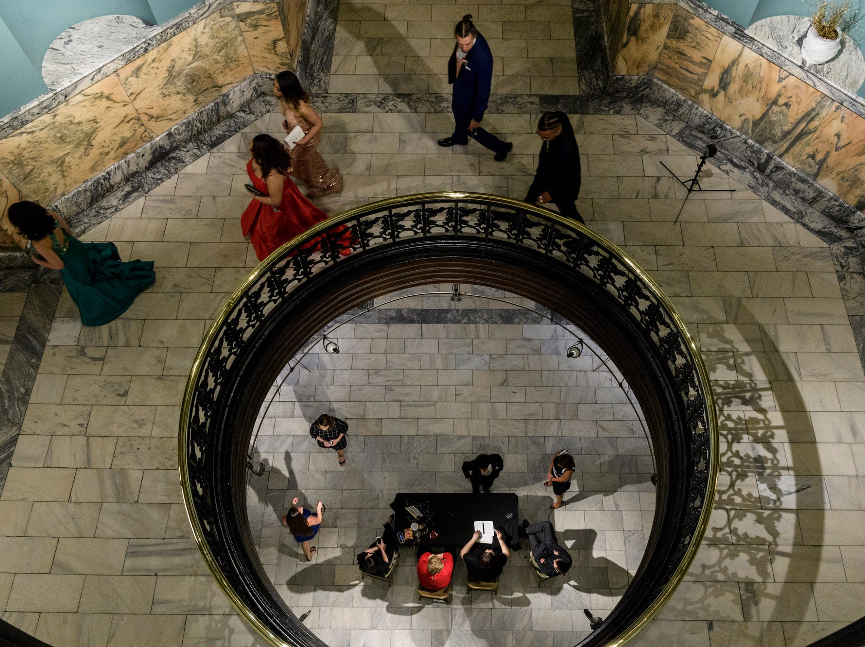 Bosse High School students check-in and then head up to the second floor to begin dancing the night away at prom inside the Old Vanderburgh County Courthouse in downtown Evansville, Ind., Saturday, April 6, 2019.