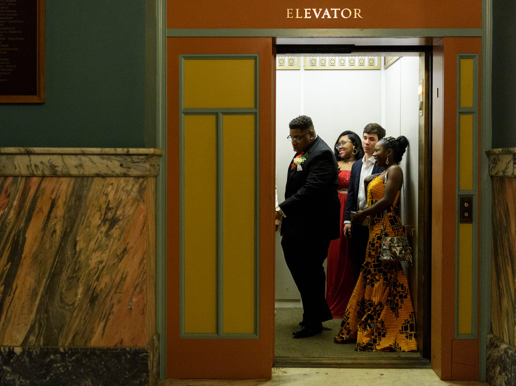 Bosse High School students take the elevator to the second floor dance room during prom at the Old Vanderburgh County Courthouse in downtown Evansville, Ind., Saturday, April 6, 2019.