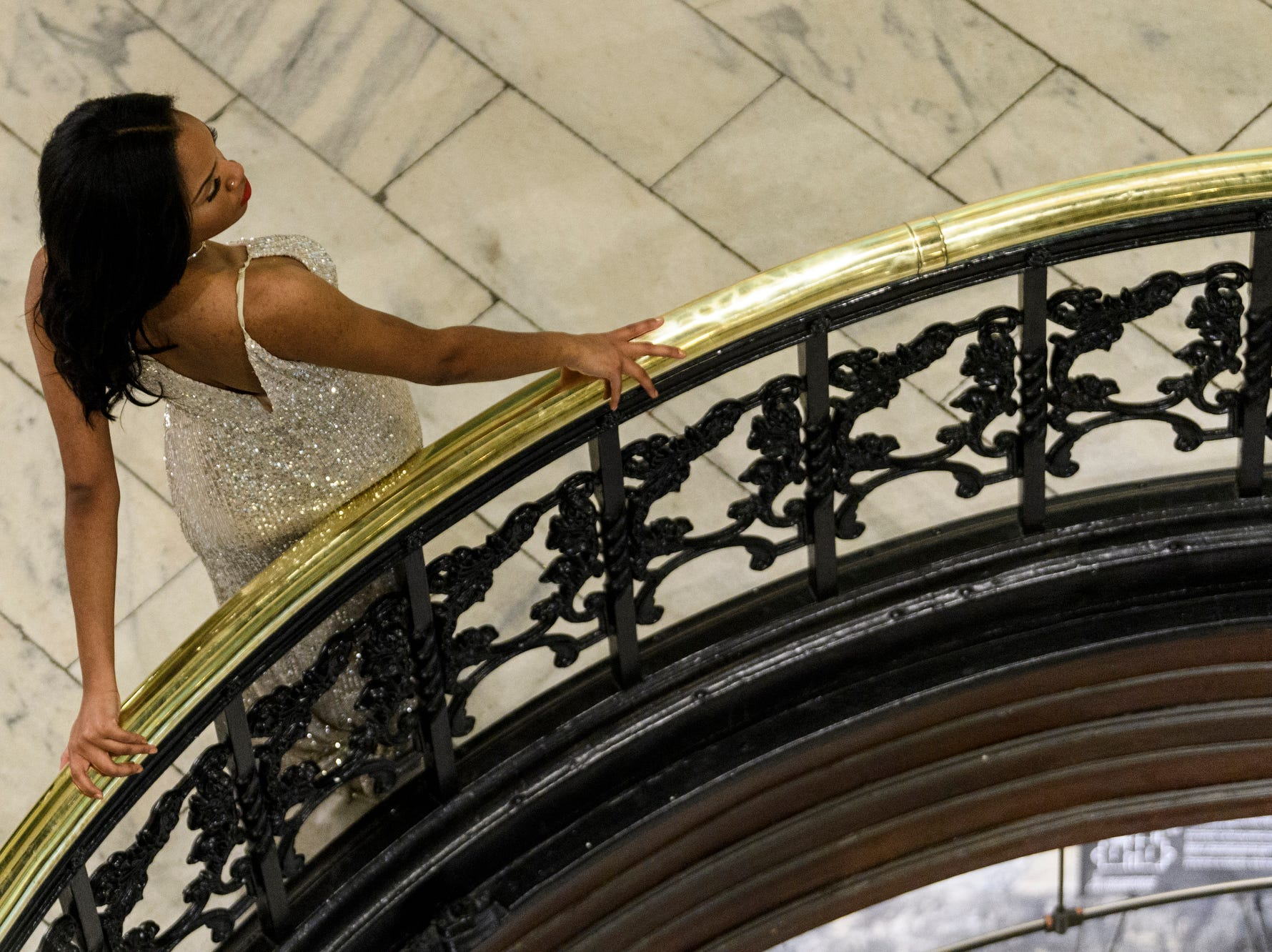 A student poses for a portrait during Bosse High School's prom on the second floor of the Vanderburgh County Courthouse in downtown Evansville, Ind., Saturday, April 6, 2019.