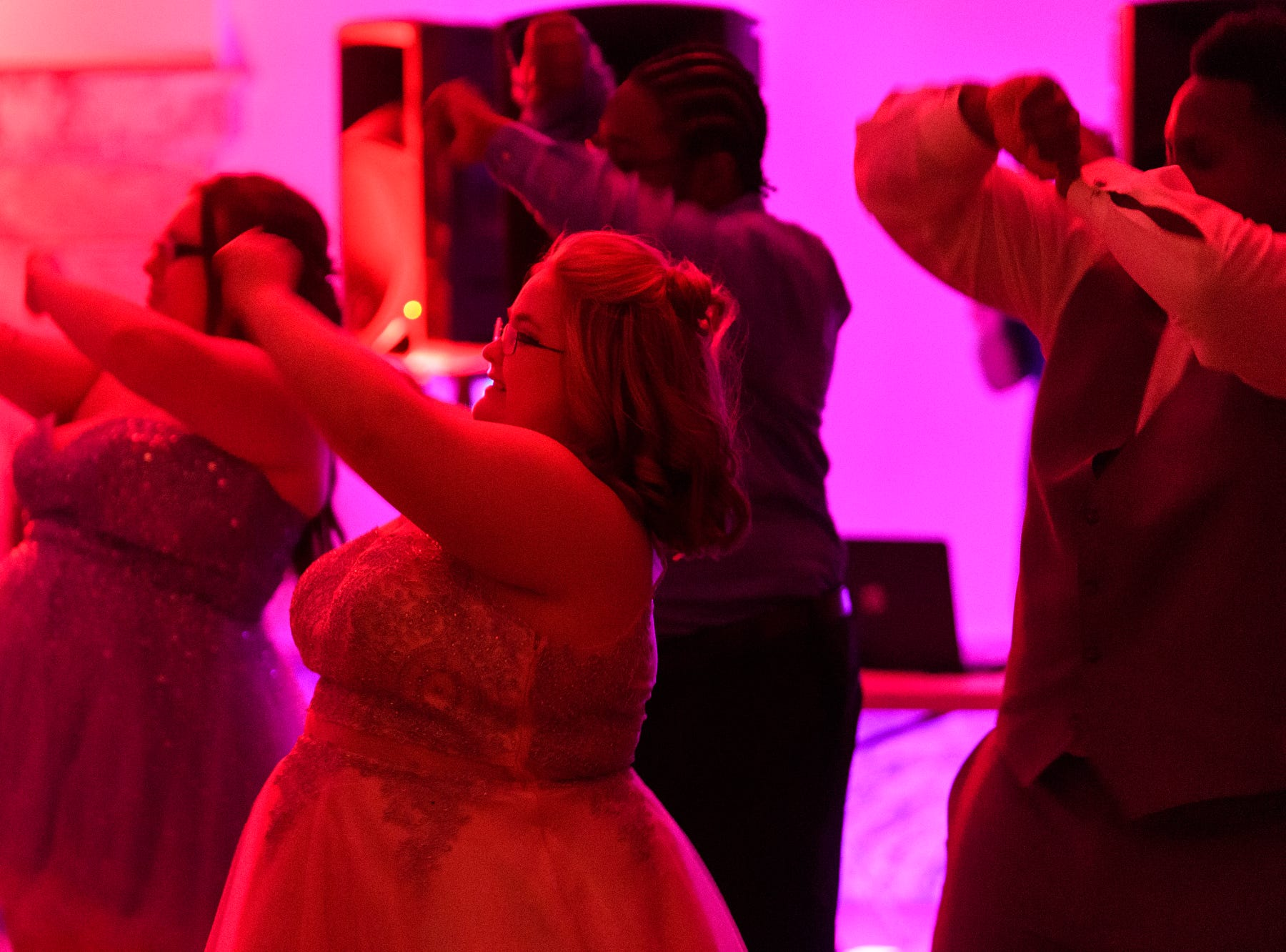 Cassidy Houston, center, dances the night away with friends during Bosse High School's prom at the Old Vanderburgh County Courthouse in downtown Evansville, Ind., Saturday, April 6, 2019.