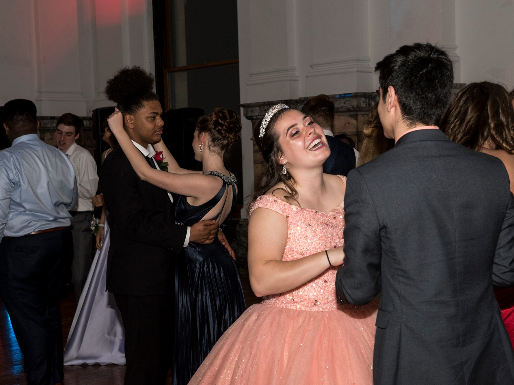 Alexa Wheeler, front left, and Junior Ordaz, front right, laugh and dance together during Bosse High School's prom at the Old Vanderburgh County Courthouse in downtown Evansville, Ind., Saturday, April 6, 2019.