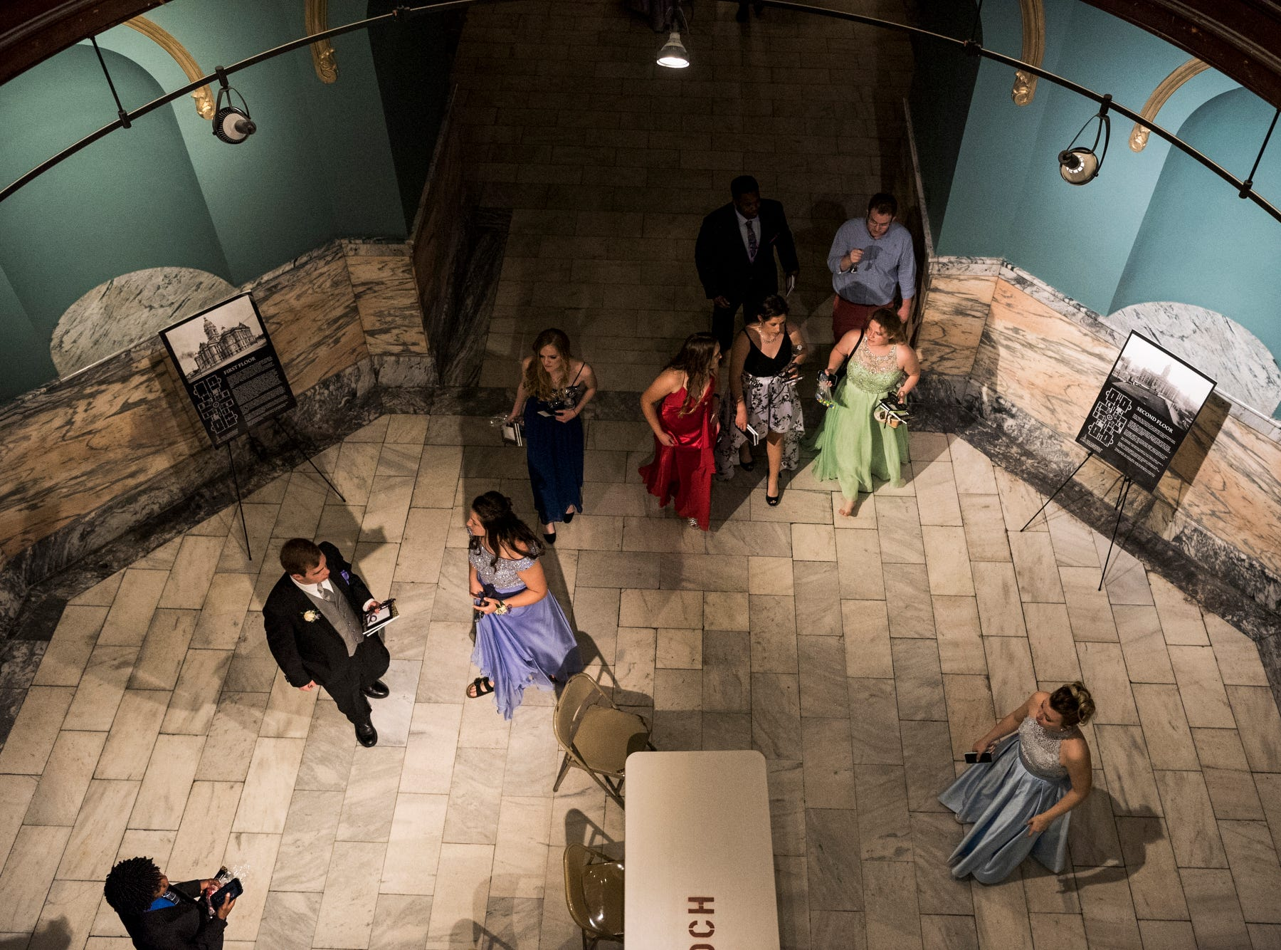 Bosse High School students leave the Old Vanderburgh County Courthouse after a night full of dancing at their prom in downtown Evansville, Ind., Saturday, April 6, 2019.