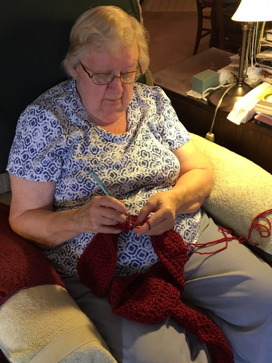 Marilyn Drake recently hit a milestone of 5,000 donations of crocheted items. The hats, scarves and prayer shawls she makes are distributed throughout the community.