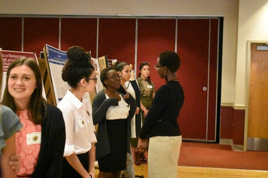 Students presented to peers and professors throughout the day.