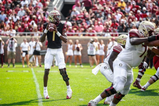 Florida State quarterback James Blackman completed 23 of 37 passes for 415 yards and three touchdowns during the Spring Game at Doak Campbell Stadium.