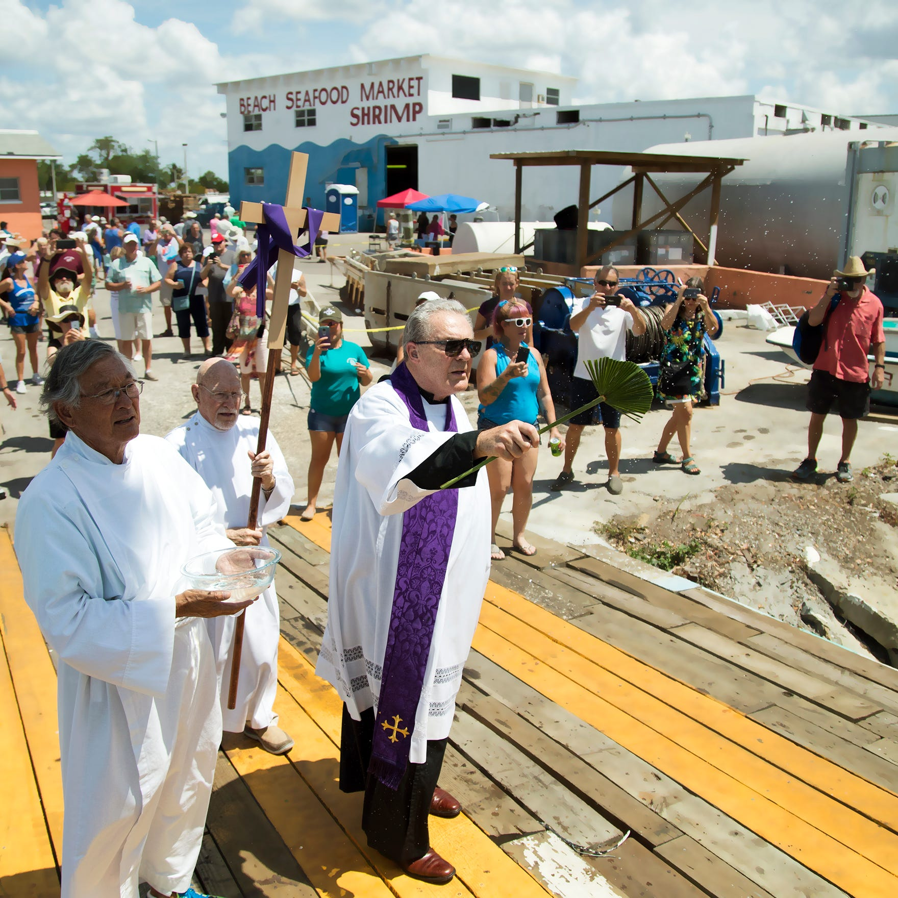 Back to the blessing: Prayers said, holy water sprinkled on Fort Myers Beach shrimp fleet