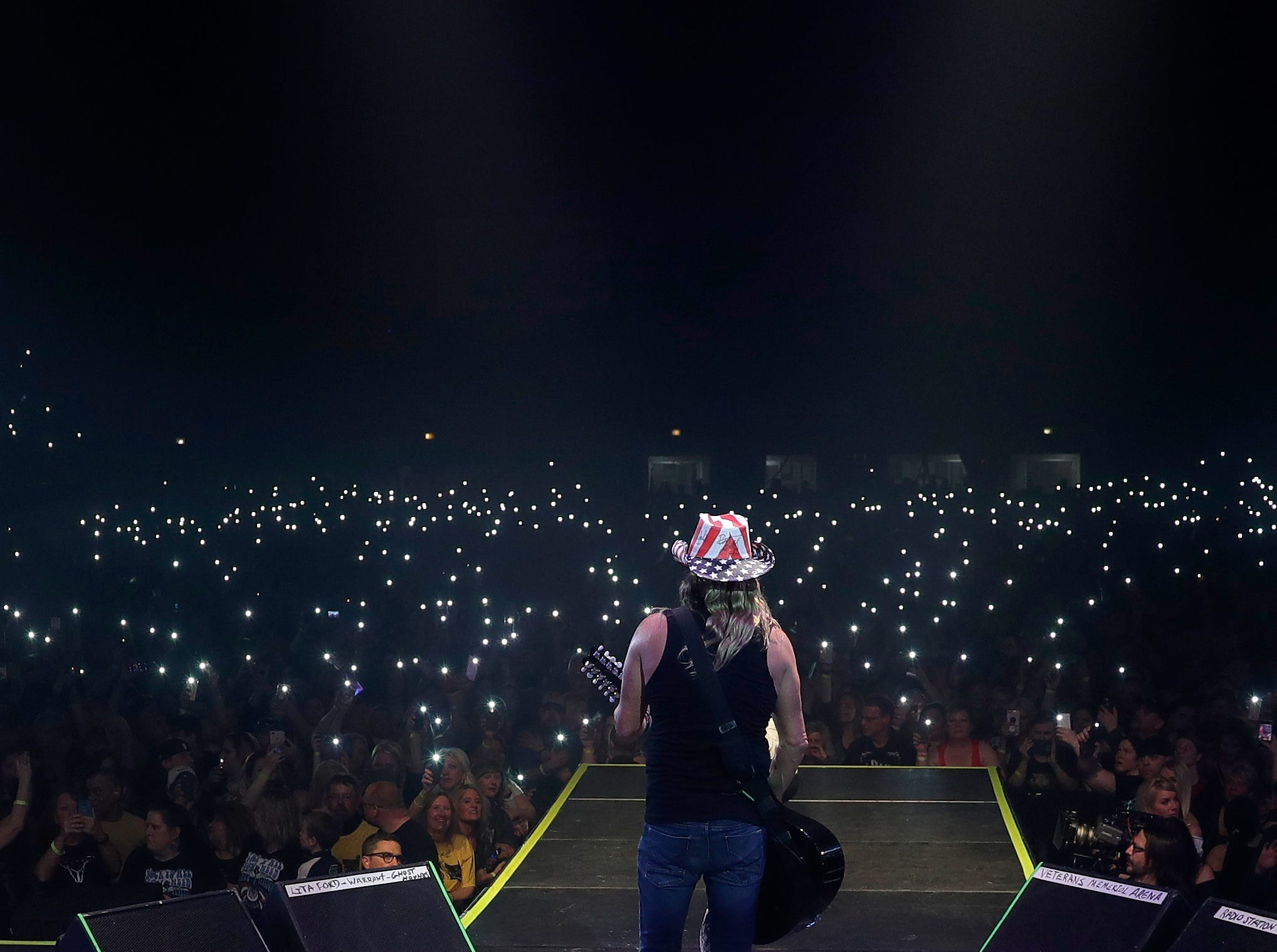 Bret Michaels plays to a sellout crowd Saturday during the last concert at Brown County Veterans Memorial Arena. He brought along a film crew to shoot the show.