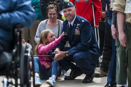 Teryn Gardner, then 10, and her father, Col. Larry Gardner, are pictured during Memorial Day ceremonies in 2016.