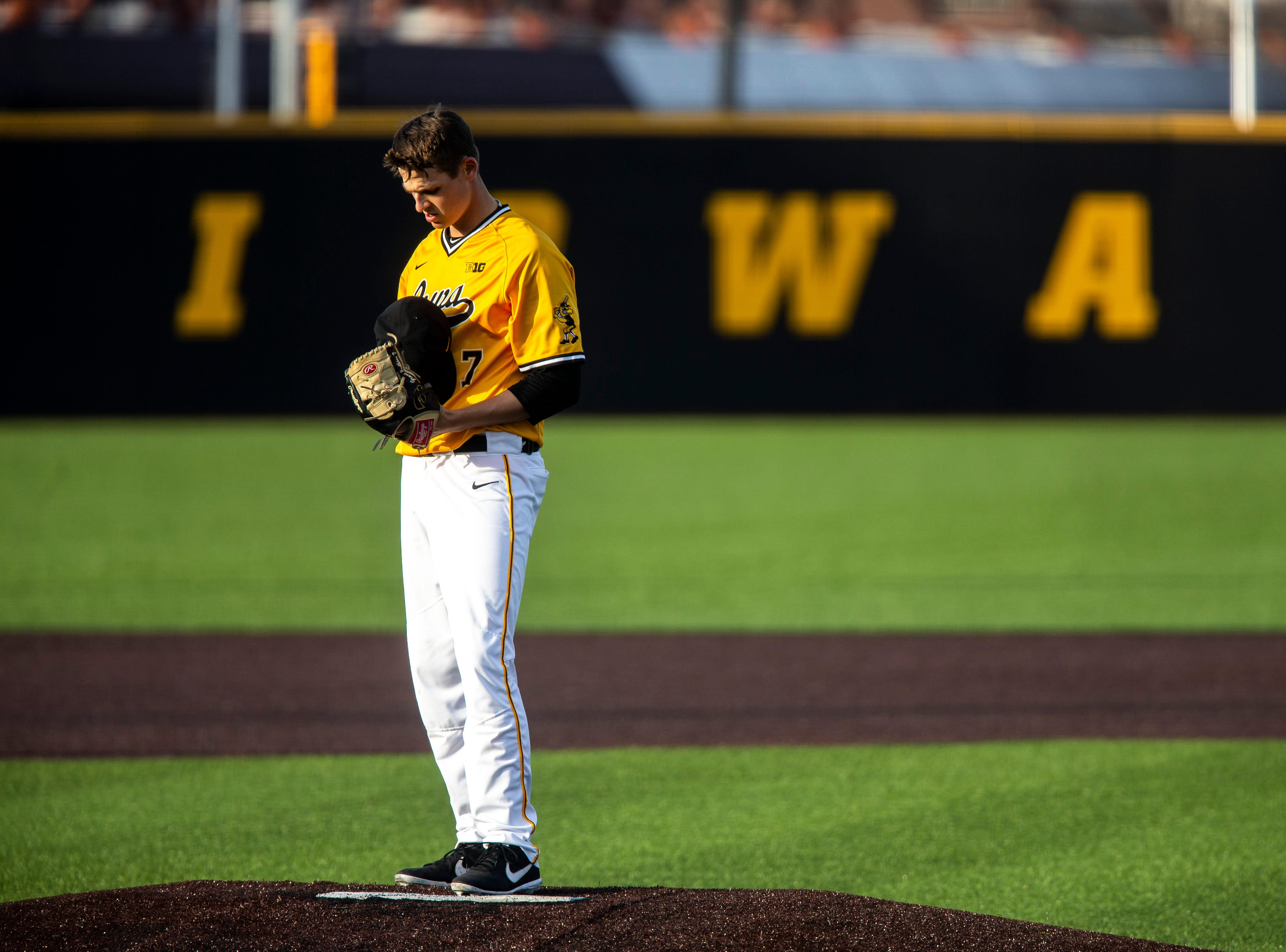 Iowa pitcher Grant Judkins (7) takes a moment on the mound between batters during a NCAA Big Ten Conference baseball game on Saturday, April 6, 2019, at Duane Banks Field in Iowa City, Iowa.