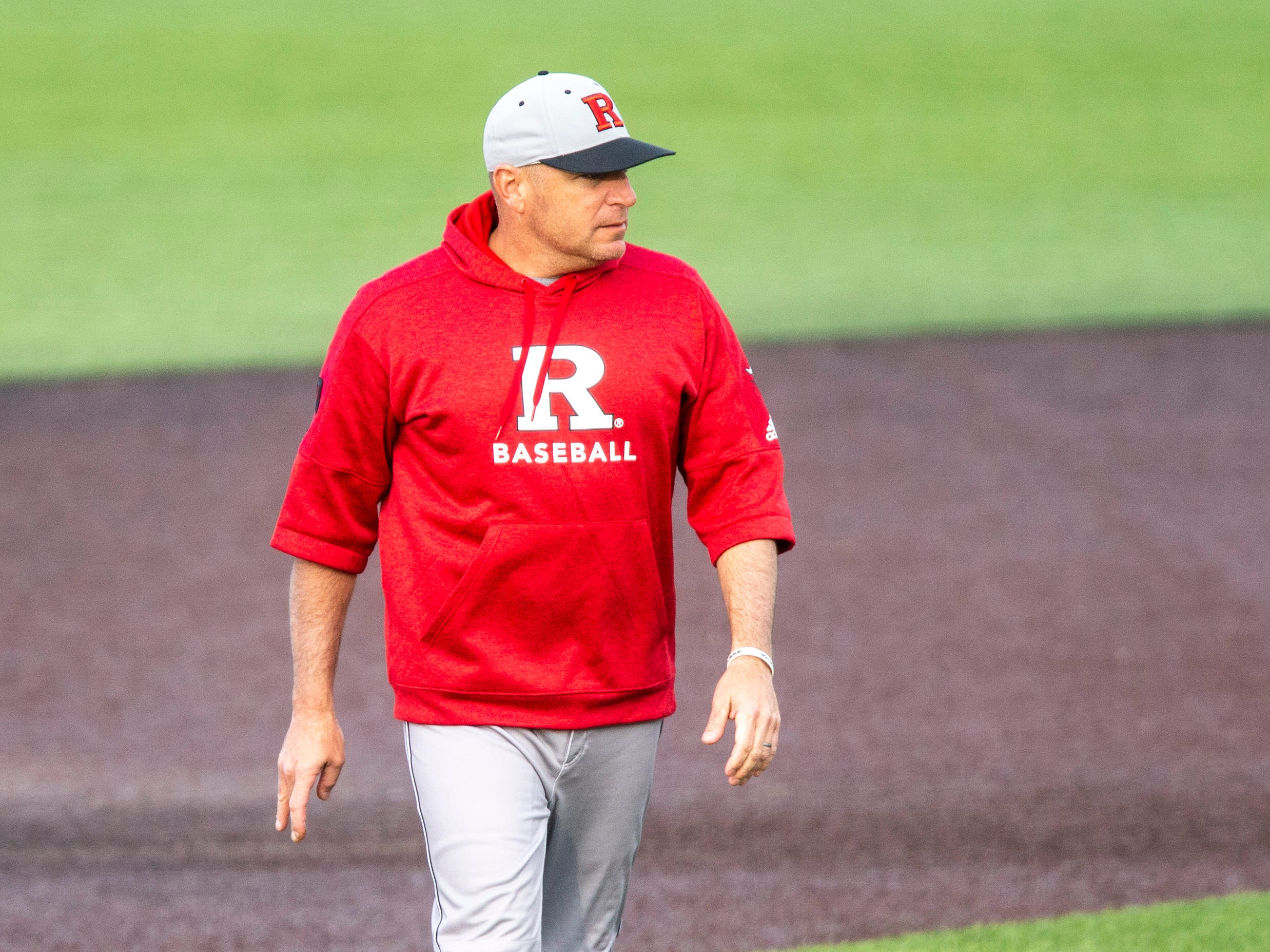 Rutgers head coach Joe Litterio walks back to the dugout during a NCAA Big Ten Conference baseball game on Saturday, April 6, 2019, at Duane Banks Field in Iowa City, Iowa.