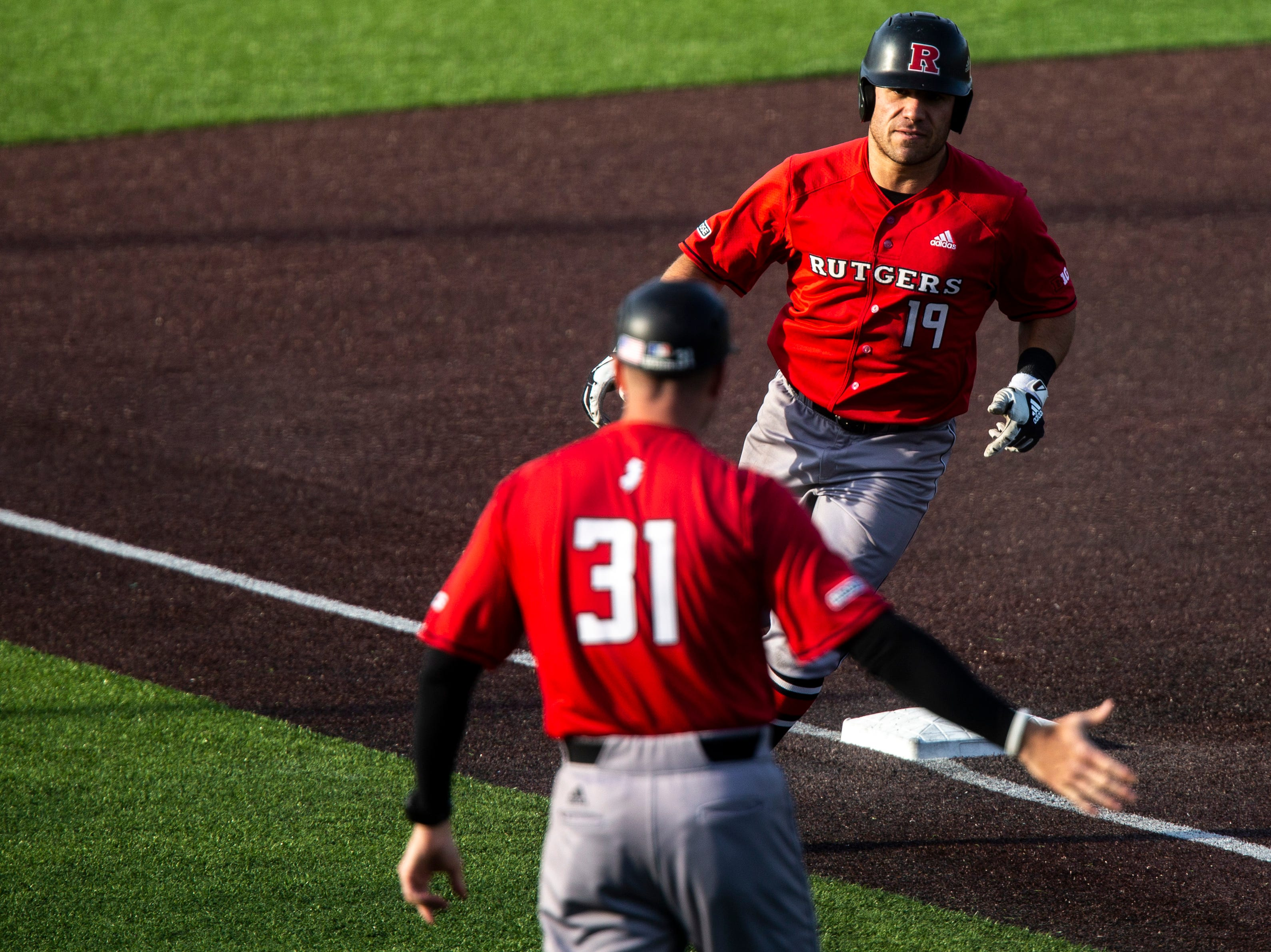 Rutgers' Carmen Sclafani rounds third on a home run during a NCAA Big Ten Conference baseball game on Saturday, April 6, 2019, at Duane Banks Field in Iowa City, Iowa.