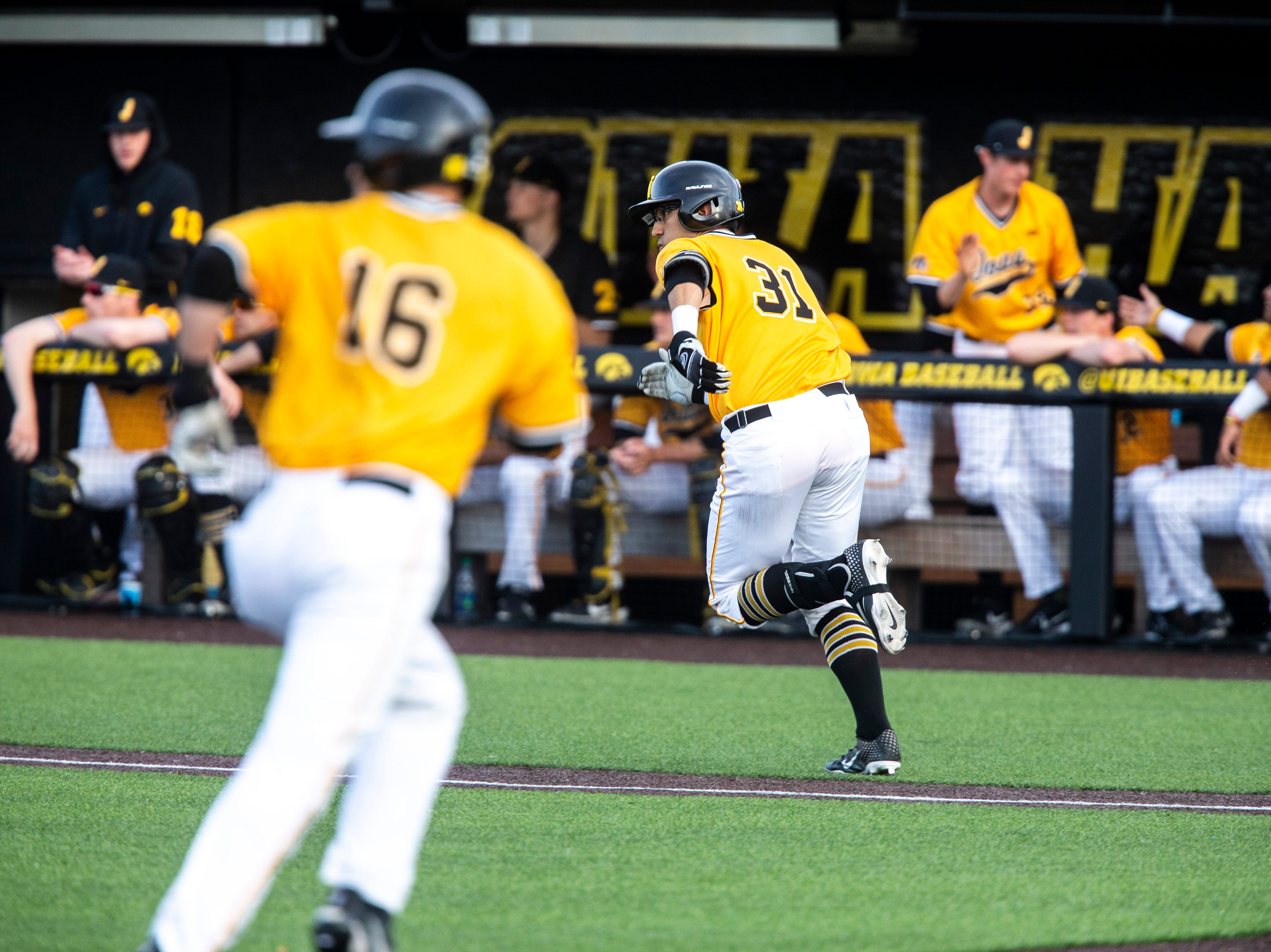 Iowa infielder Matthew Sosa (31) runs to first while Tanner Wetrich (16) scores a run during a NCAA Big Ten Conference baseball game on Saturday, April 6, 2019, at Duane Banks Field in Iowa City, Iowa.