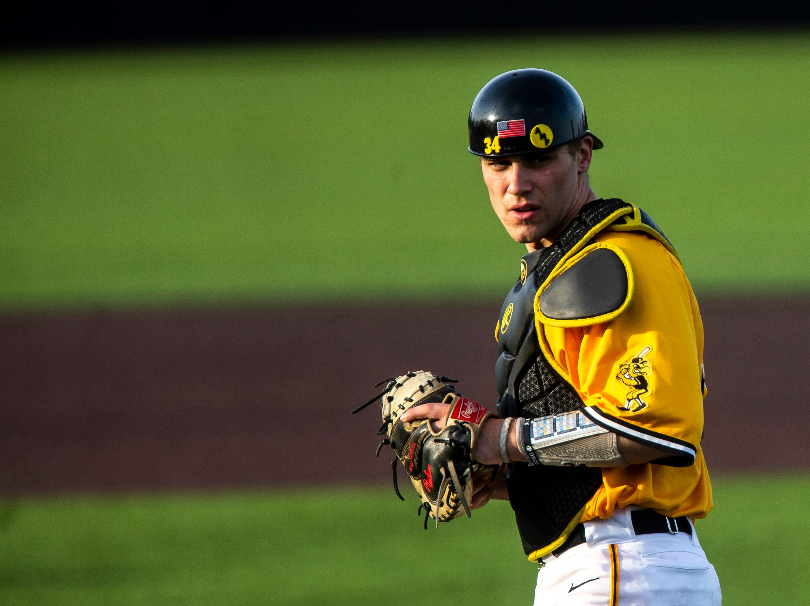 Iowa catcher Austin Martin (34) walks out to the plate during a NCAA Big Ten Conference baseball game on Saturday, April 6, 2019, at Duane Banks Field in Iowa City, Iowa.