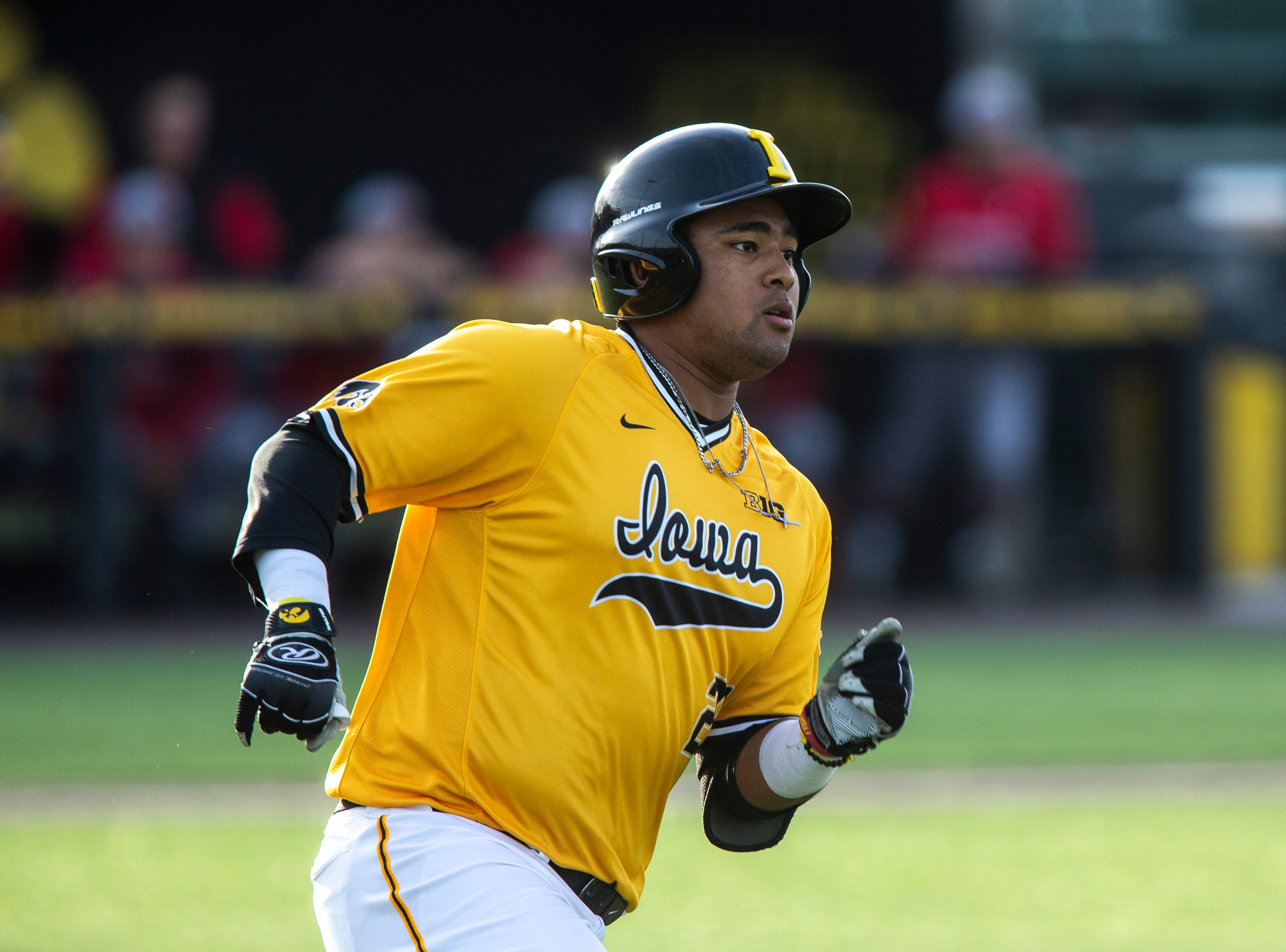 Iowa infielder Izaya Fullard (20) runs to first on a single during a NCAA Big Ten Conference baseball game on Saturday, April 6, 2019, at Duane Banks Field in Iowa City, Iowa.