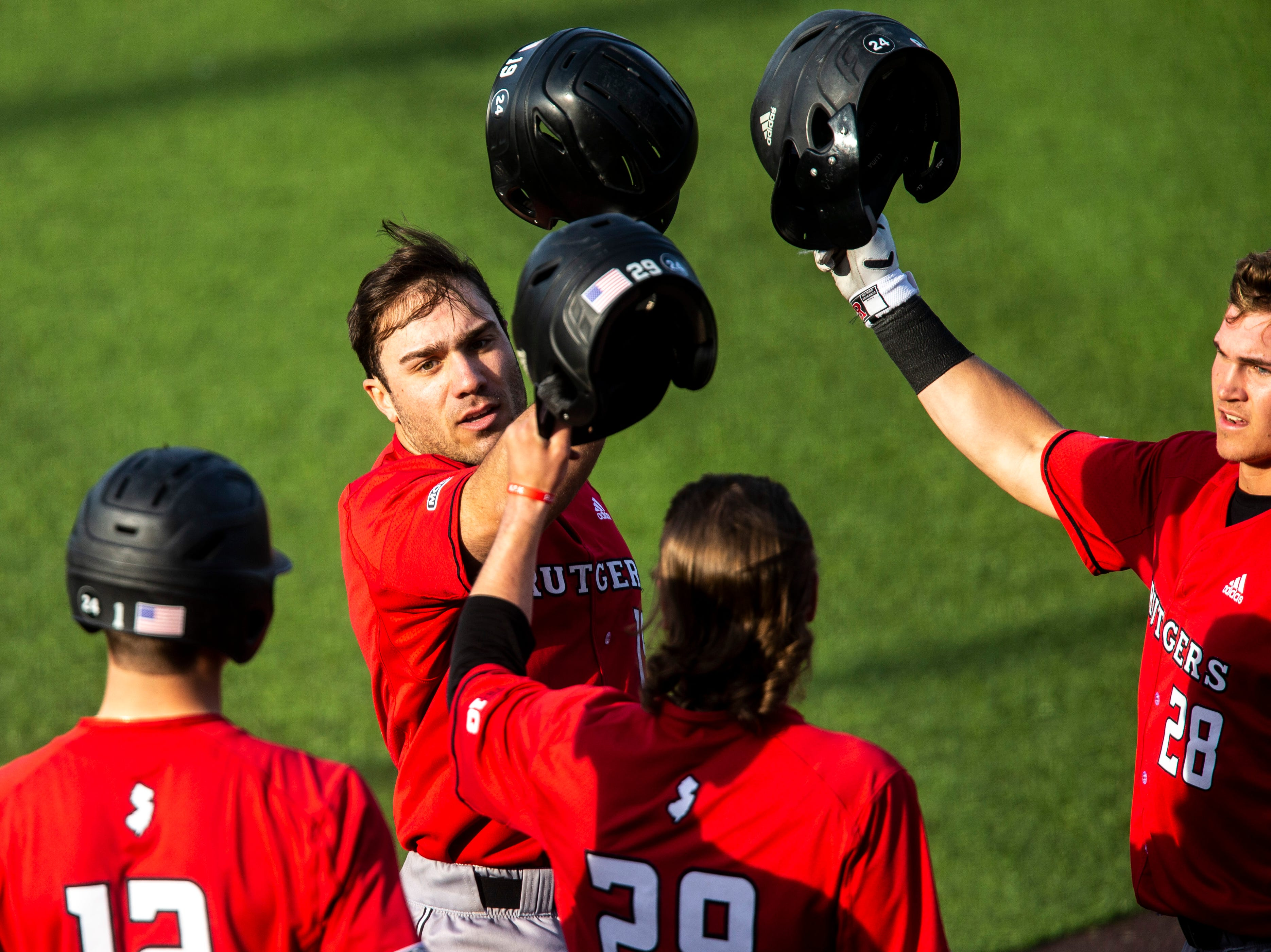Rutgers' Carmen Sclafani celebrates with teammates after scoring a home run during a NCAA Big Ten Conference baseball game on Saturday, April 6, 2019, at Duane Banks Field in Iowa City, Iowa.